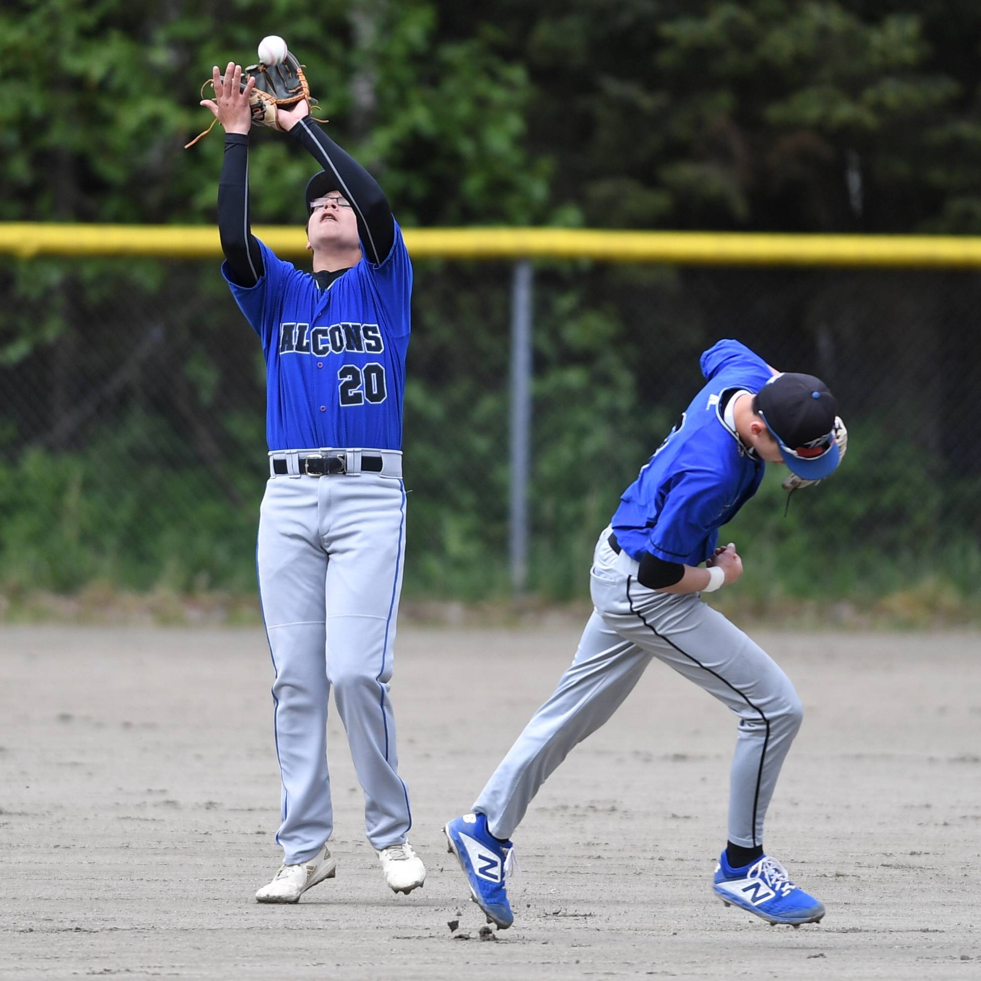 Thunder Mountain's Oliver Mendoza catches a fly all against Sitka as teammate Bryson Echiverri ducks out of the way during the Region V Baseball Championship at Adair-Kennedy Memorial Park on Friday, May 24, 2019. (Michael Penn | Juneau Empire)