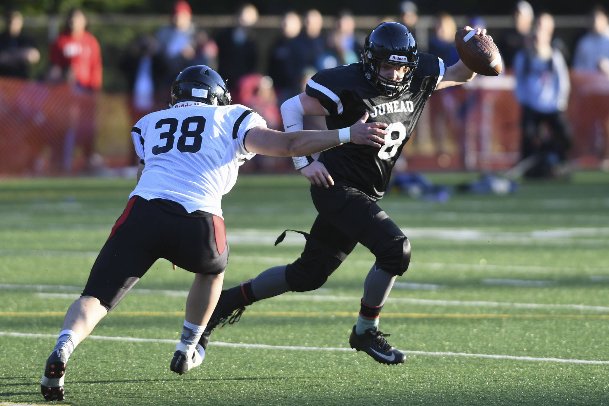 Legends' Stefan Jones, right, is pursued by Stars' Dylan Skrzynski in the Juneau Alumni Football Game with football players, dance team members and cheerleaders from Juneau-Douglas and Thunder Mountain High Schools at Adair-Kennedy Memorial Field on Friday, May 24, 2019. (Michael Penn | Juneau Empire)