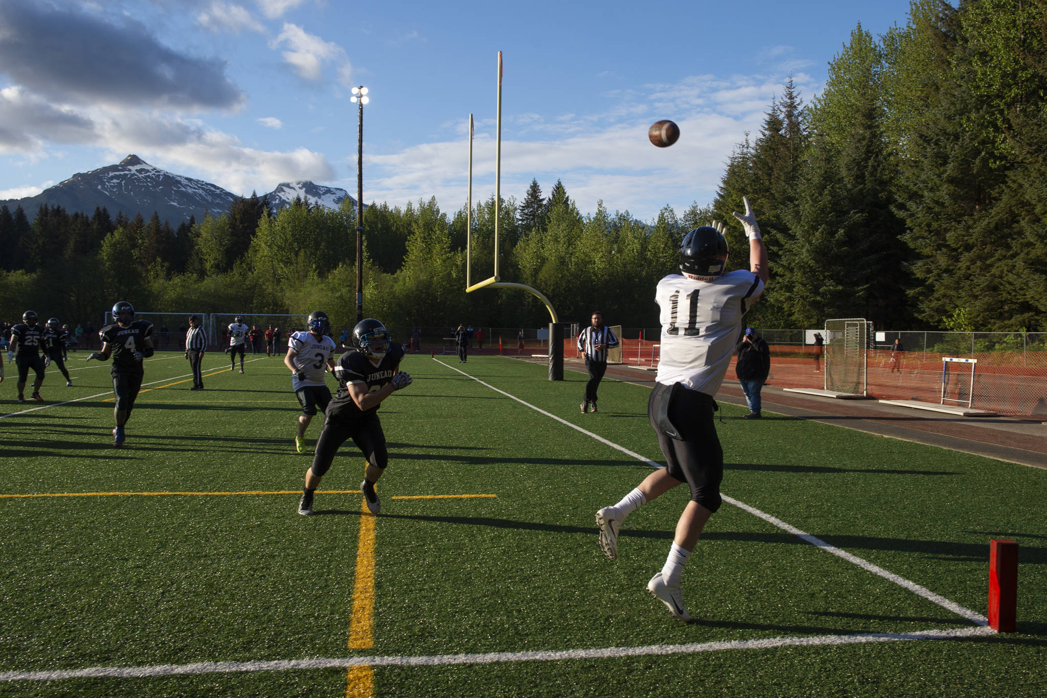 Stars' Ryan Fagerstrom makes a reception for the first touchdown of the night at the Juneau Alumni Football Game with football players, dance team members and cheerleaders from Juneau-Douglas and Thunder Mountain High Schools at Adair-Kennedy Memorial Field on Friday, May 24, 2019. (Michael Penn | Juneau Empire)
