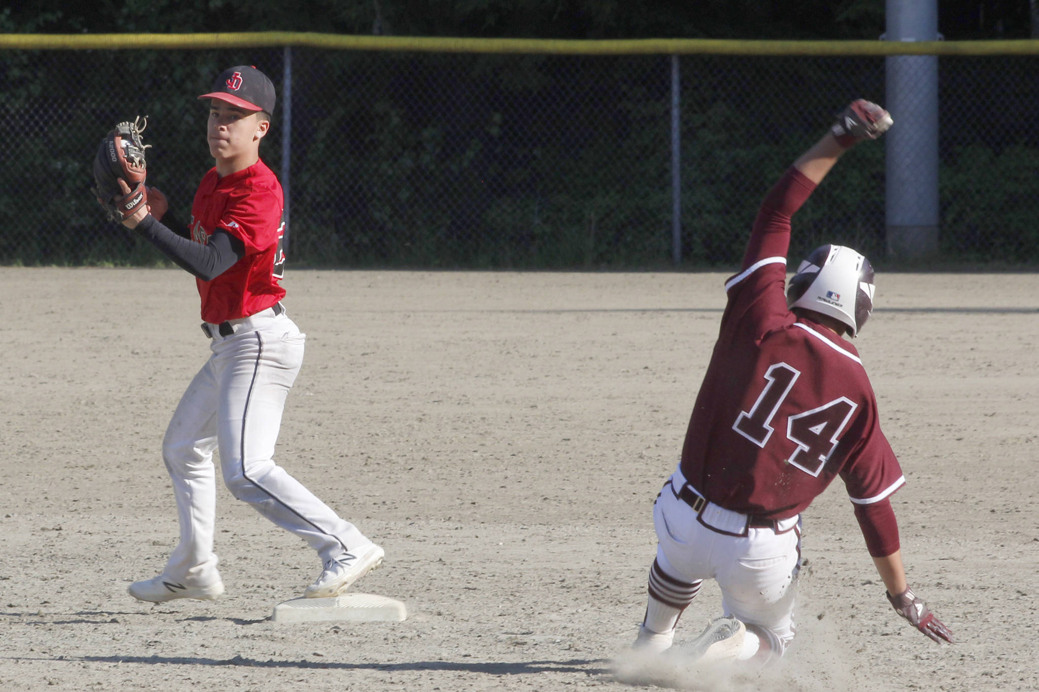 Juneau-Douglas High School: Yadaa.at Kale second baseman Gaby Soto forces out Ketchikan's C.J. Paule during the Region V title game against Ketchikan on Saturday, May 25, 2019. (Alex McCarthy | Juneau Empire)