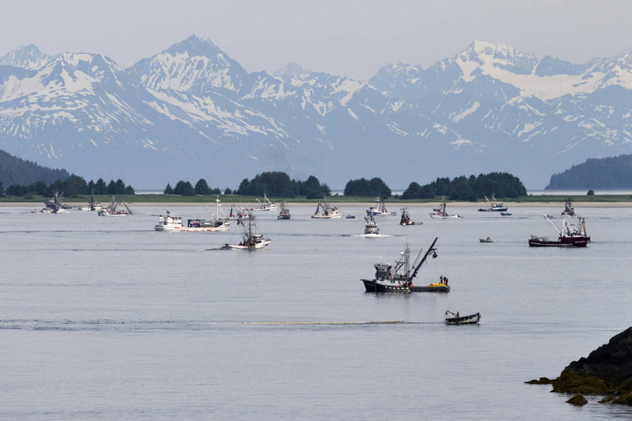 Purse seiners work the waters for salmon near Amalga Harbor in Favorite Channel during an opening in July 2012. (Michael Penn | Juneau Empire File)