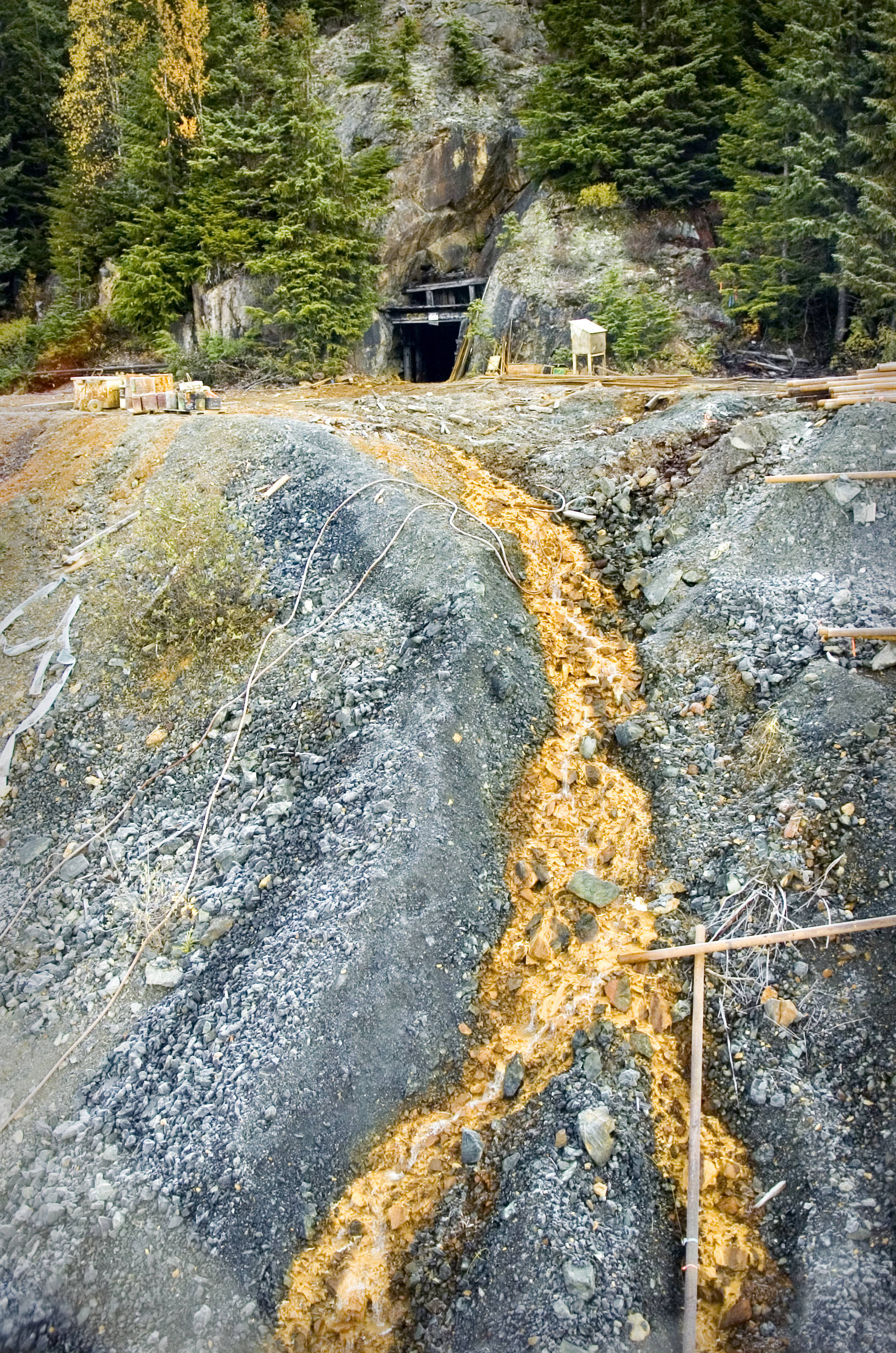 Acid contaminated water runs from the entrance of the Tulsequah Chief Mine in Canada in October 2018. Eight U.S. senators sent a letter Thursday to British Columbia, Canada's premier asking for more transboundary water oversight. (Michael Penn | Juneau Empire)
