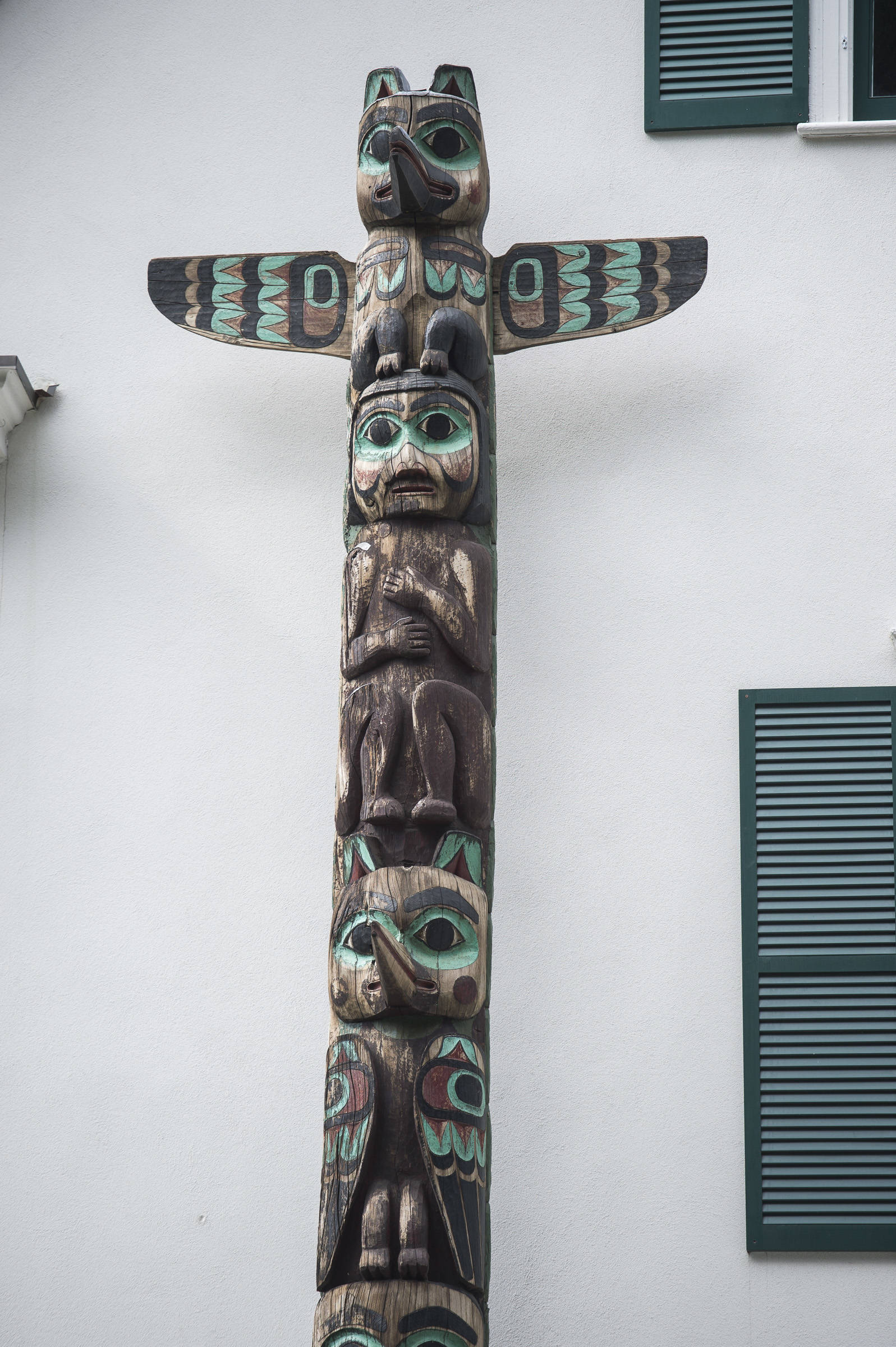 The totem at the Governor's House is an example of totems carved by people employed by the Civilian Conservation Corps. (Michael Penn | Juneau Empire)