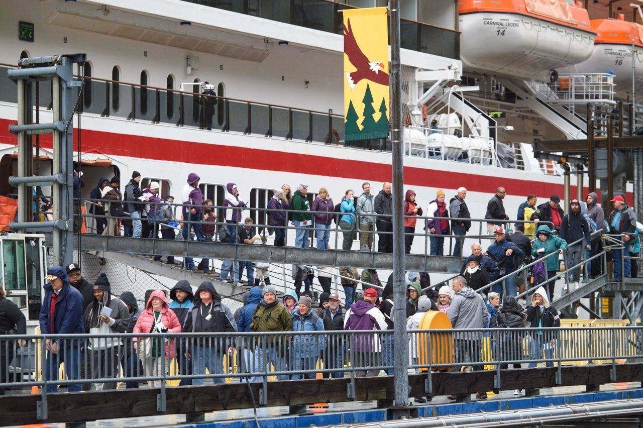Passengers disembark from the cruise ship Carnival Legend at the South Franklin Dock on Wednesday, May 8, 2019. The company was cited for excess air pollution last year. (Michael Penn | Juneau Empire)