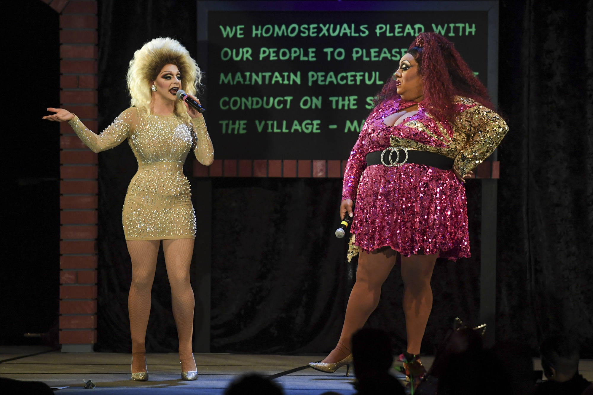 Gigi Monroe, left, shares the stage with Kelexis Davenport, of Dallas, Texas, the fifth annual GLITZ Drag Show in honor of the 50th Anniversary of the Stonewall Riots and Juneau Pride Kickoff! at Centennial Hall on Friday, June 14, 2019. (Michael Penn | Juneau Empire)