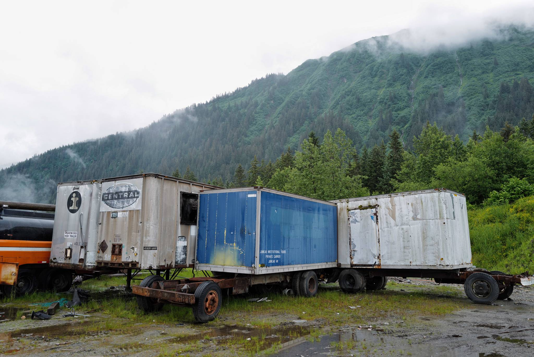 Shipping containers are pictured in a lot on Valley Boulevard on Tuesday, June 18, 2019. Capital City Fire/Rescue responded to fire set in two of the containers on Monday. (Michael Penn | Juneau Empire)