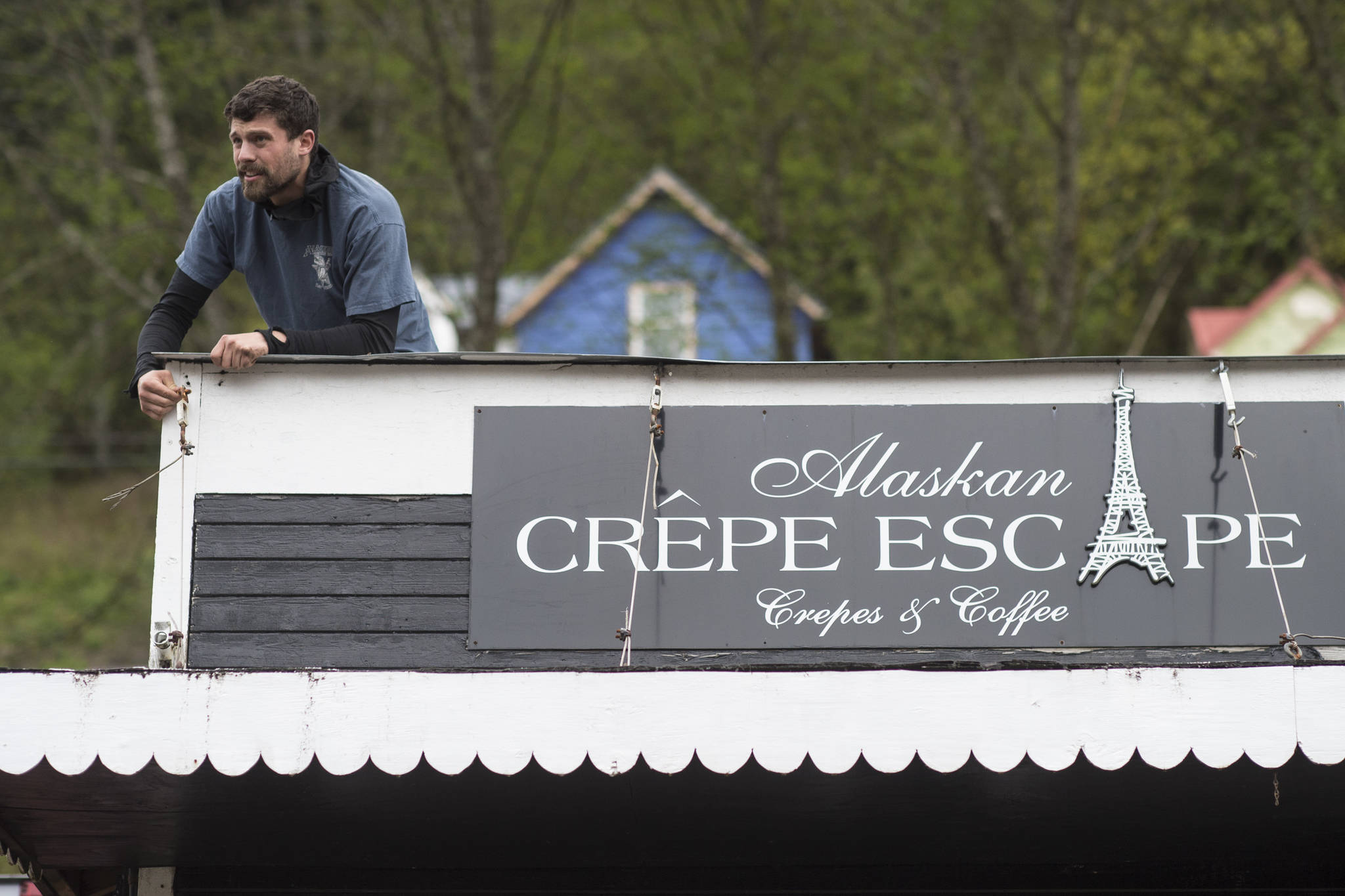 Dave McCasland, owner of Deckhand Dave's Fish Tacos, sets up lights on food truck businesses being setup at Gunakedeit Park, also known as Pocket Park, on Thursday, May 9, 2019. The businesses are expected to be open by Monday. (Michael Penn | Juneau Empire)