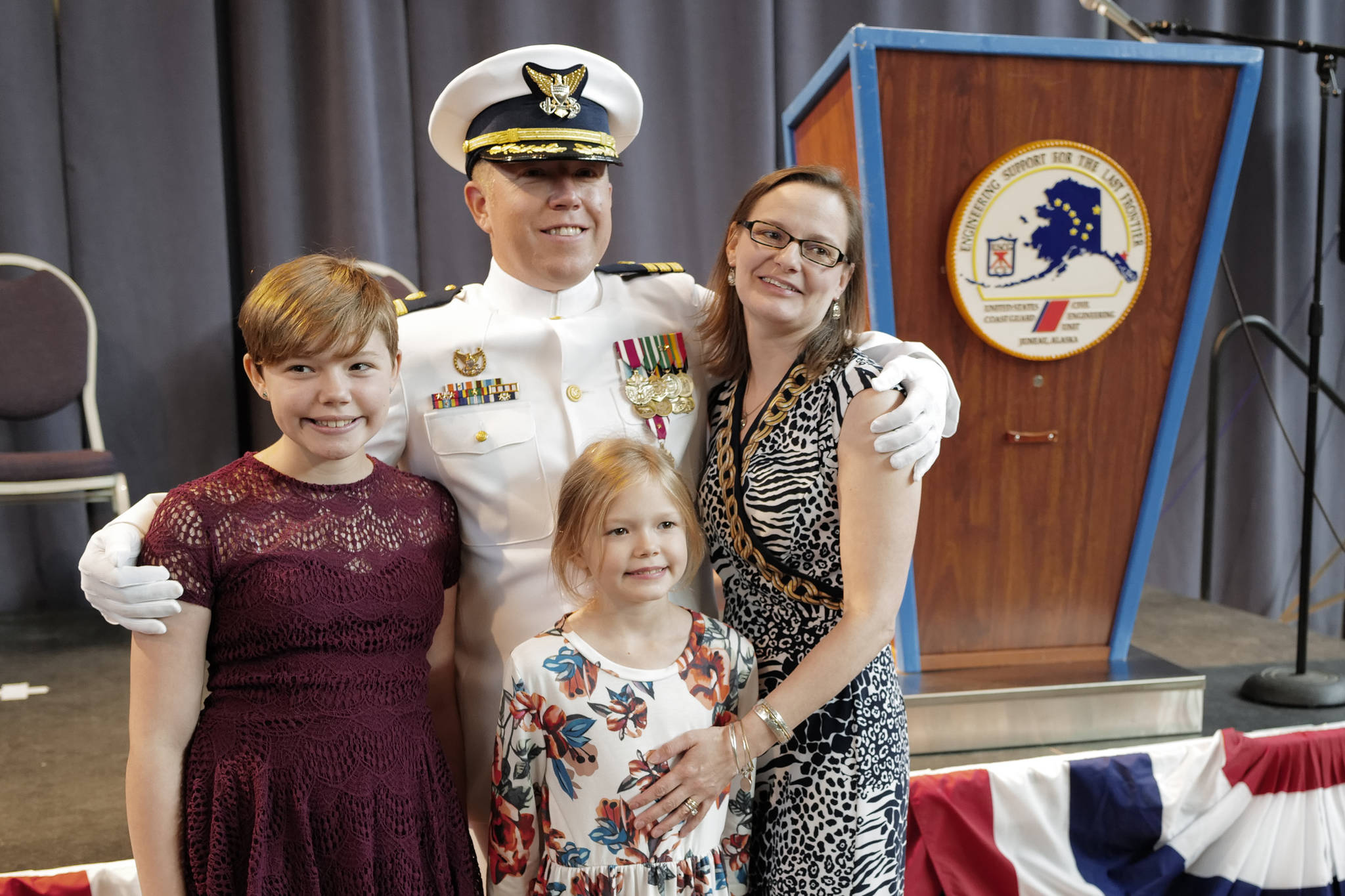 U.S. Coast Guard Commander Andrew S. Joca poses with his wife, Katie, and daughters, Molly, 11, and Amelia, 8, after a Change of Command ceremony at the Juneau Arts and Culture Center on Thursday, June 20, 2019. (Michael Penn | Juneau Empire)