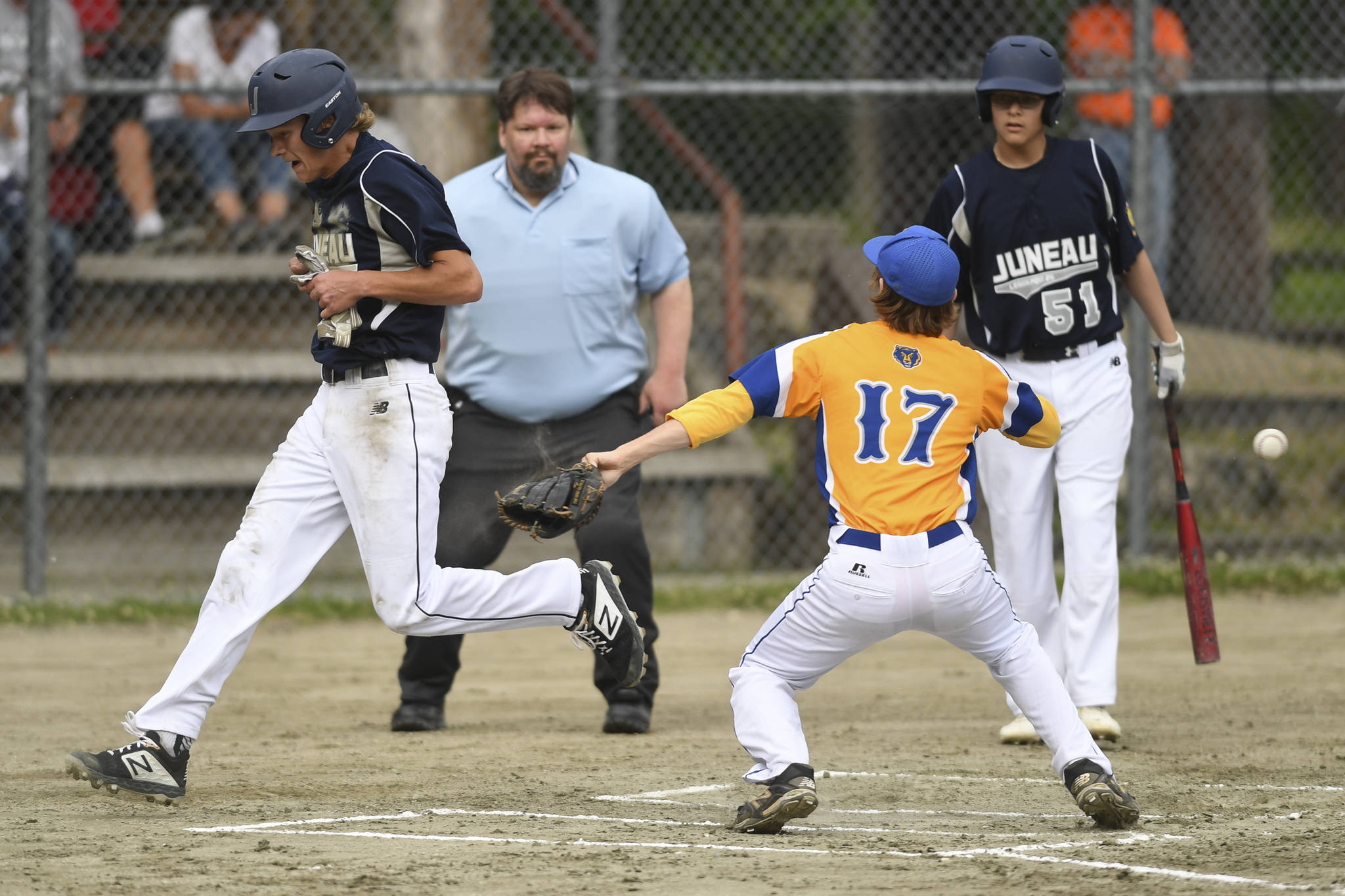 Juneau's Gabe Storie steals home on a passed ball in the first inning against Bartlett's pitcher Nelson Korshin in Legion League baseball at Adair-Kennedy Memorial Park on Friday, June 21, 2019. (Michael Penn   Juneau Empire)