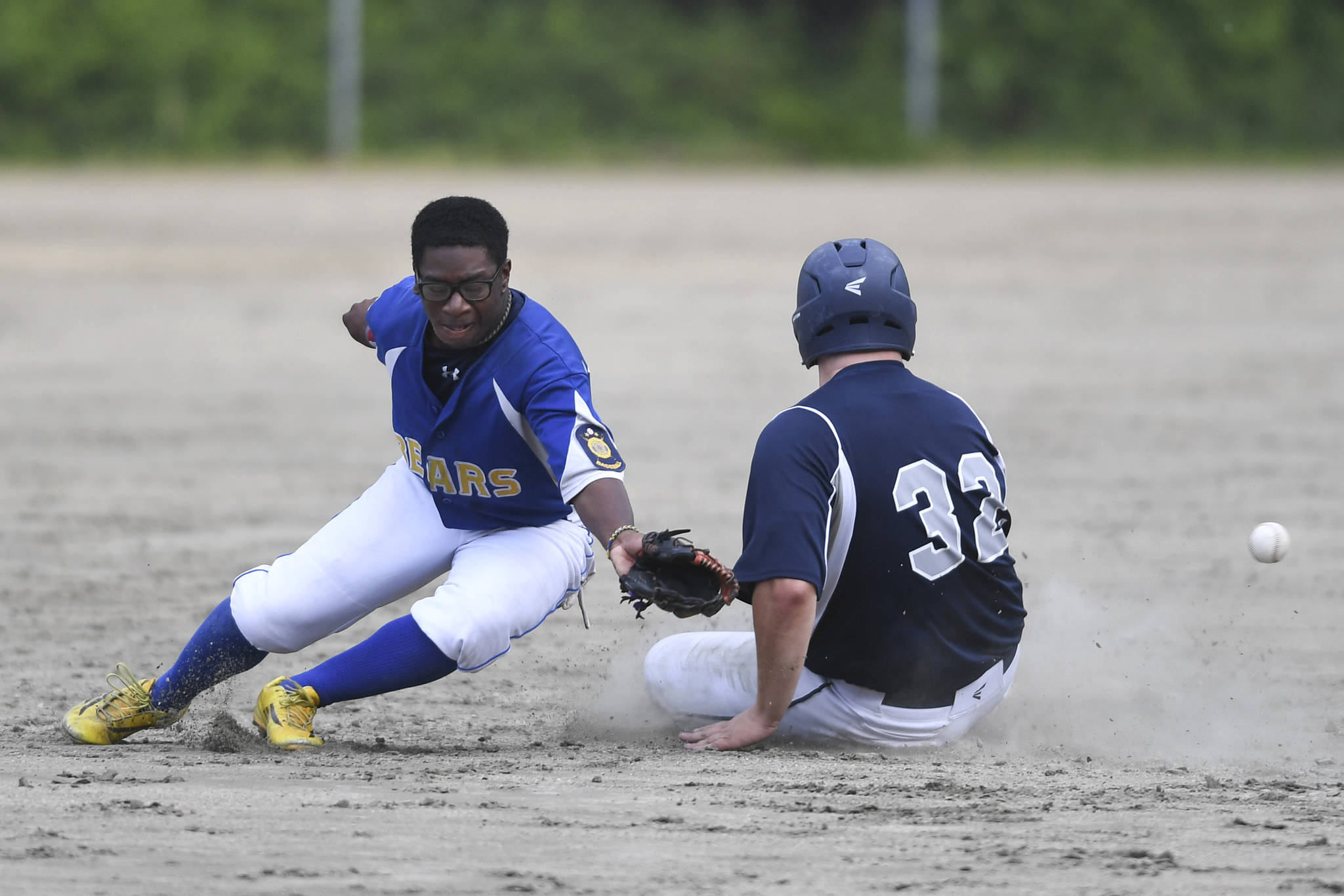 Juneau's Robert Cox, right, steal second against Bartlett's Ian Byrd in the fourth inning in Legion League baseball at Adair-Kennedy Memorial Park on Friday, June 21, 2019. (Michael Penn | Juneau Empire)