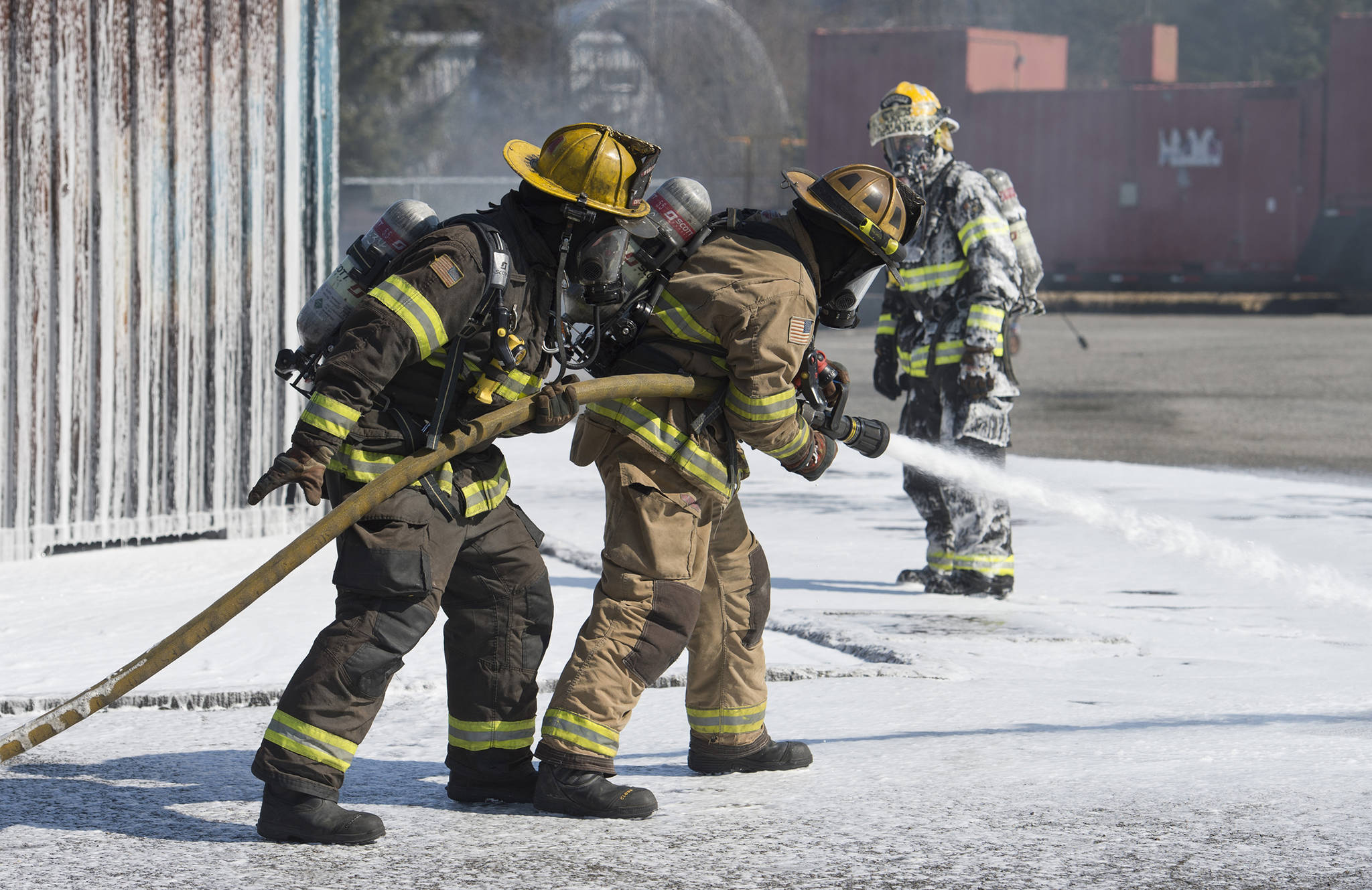In this file photo taken April 13, 2017, Brady Fink, center, and Dave Edmunds, left, are watched by Engineer Lance Lawhorne as they update their airport rescue firefighting skills at the Hagevig Regional Fire Training Center. A potentially harmful chemical was detected at the center after soil and water testing at the center. (Michael Penn | Juneau Empire File)