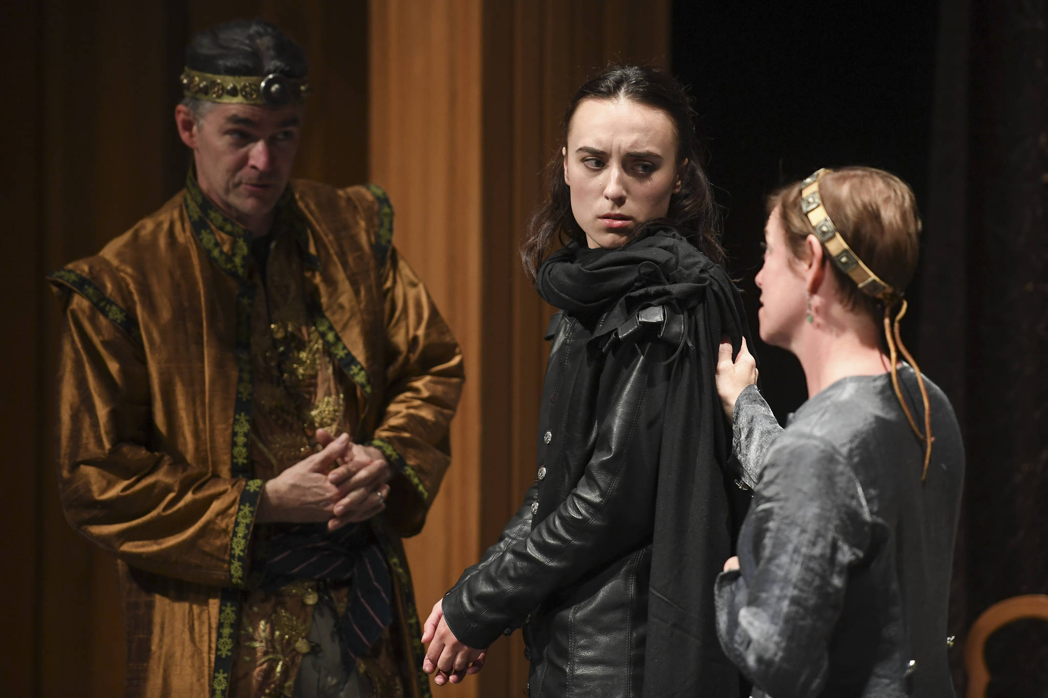 "Natalia Spengler, center, plays Hamlet with Donice Gott, as his mother Gertrude, Queen of Denmark, and Aaron Elmore as Claudius, King of Denmark, during a performance of William Shakespeare's ""Hamlet"" by Theatre in the Rough at McPhetres Hall on Tuesday, July 2, 2019. (Michael Penn 