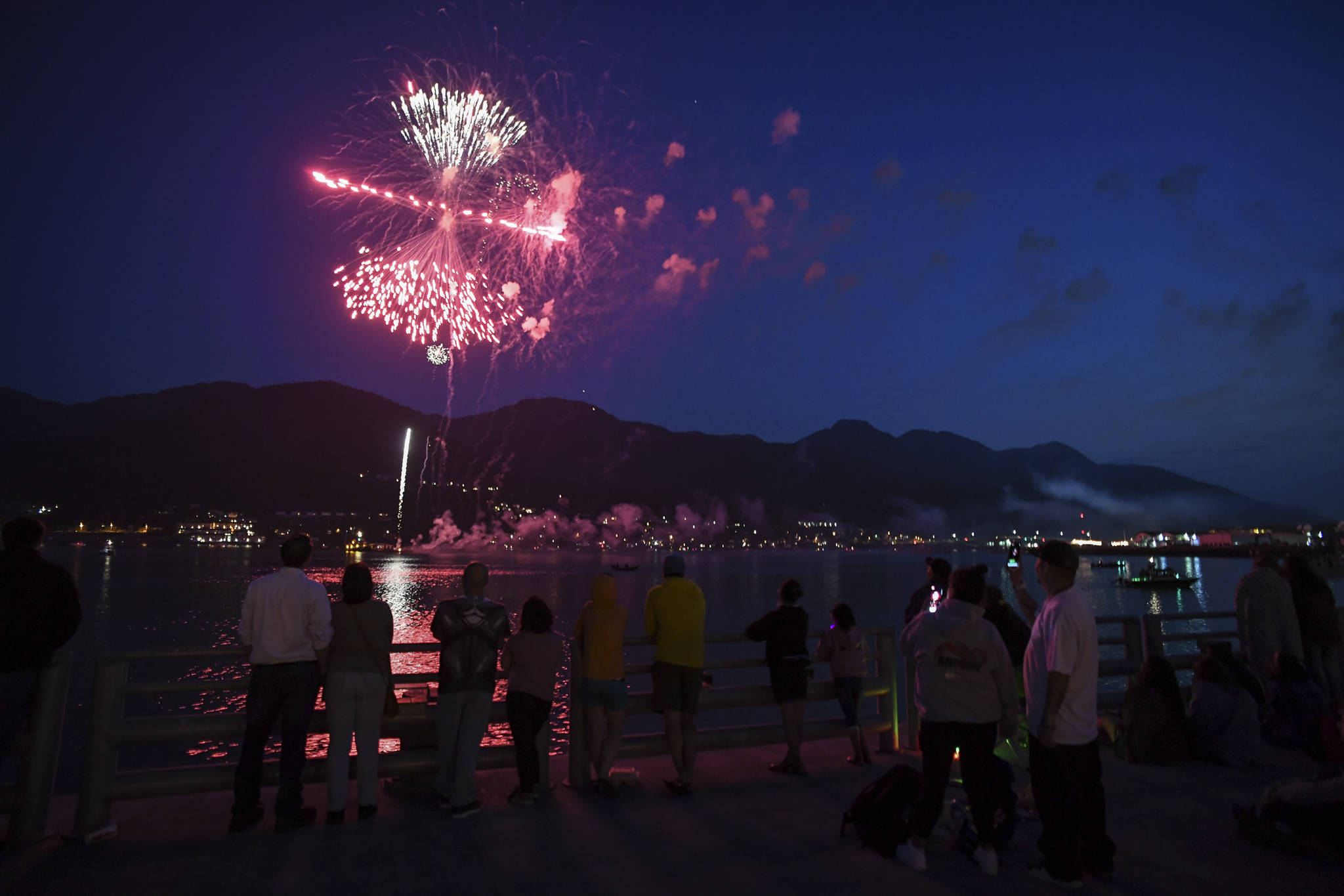 Juneau residents gather around the downtown waterfront to watch the annual fireworks display on Wednesday, July 3, 2019. (Michael Penn | Juneau Empire)