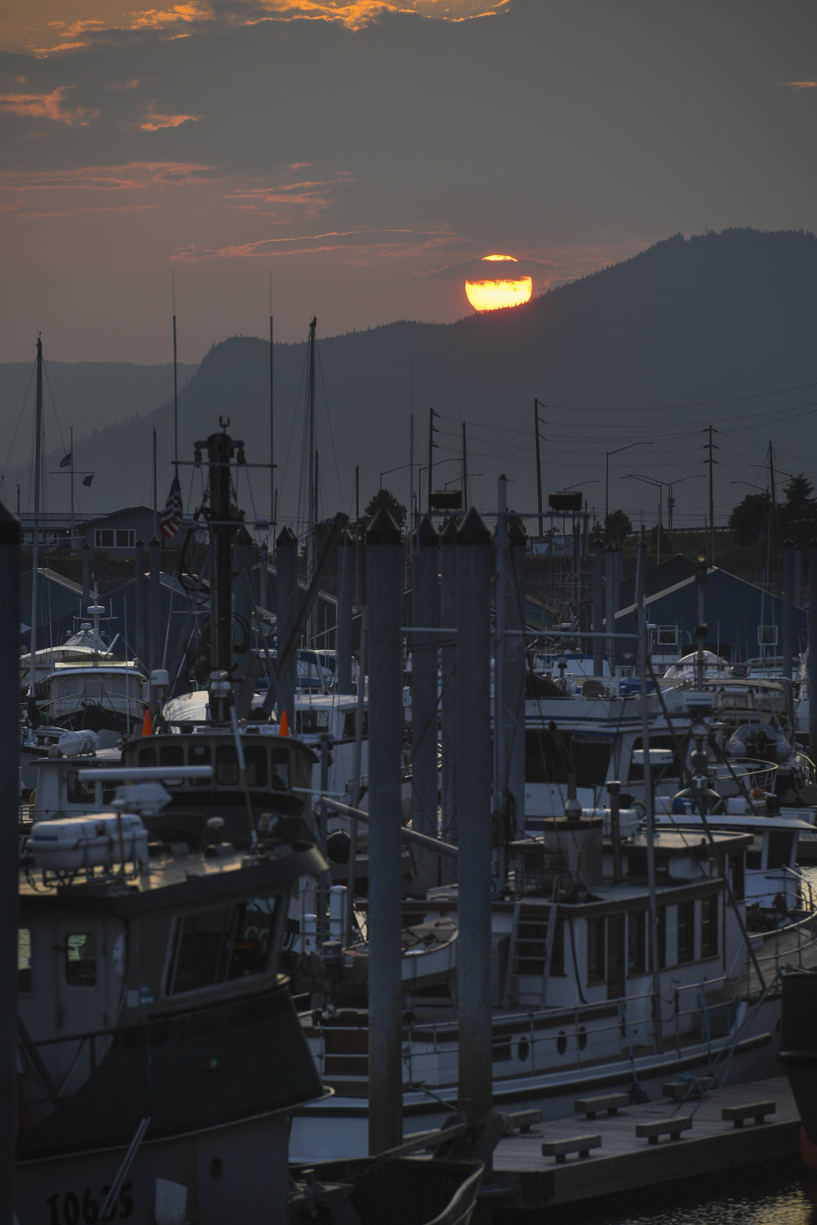 The sun sets over Aurora Harbor on Wednesday, July 3, 2019. (Michael Penn | Juneau Empire)