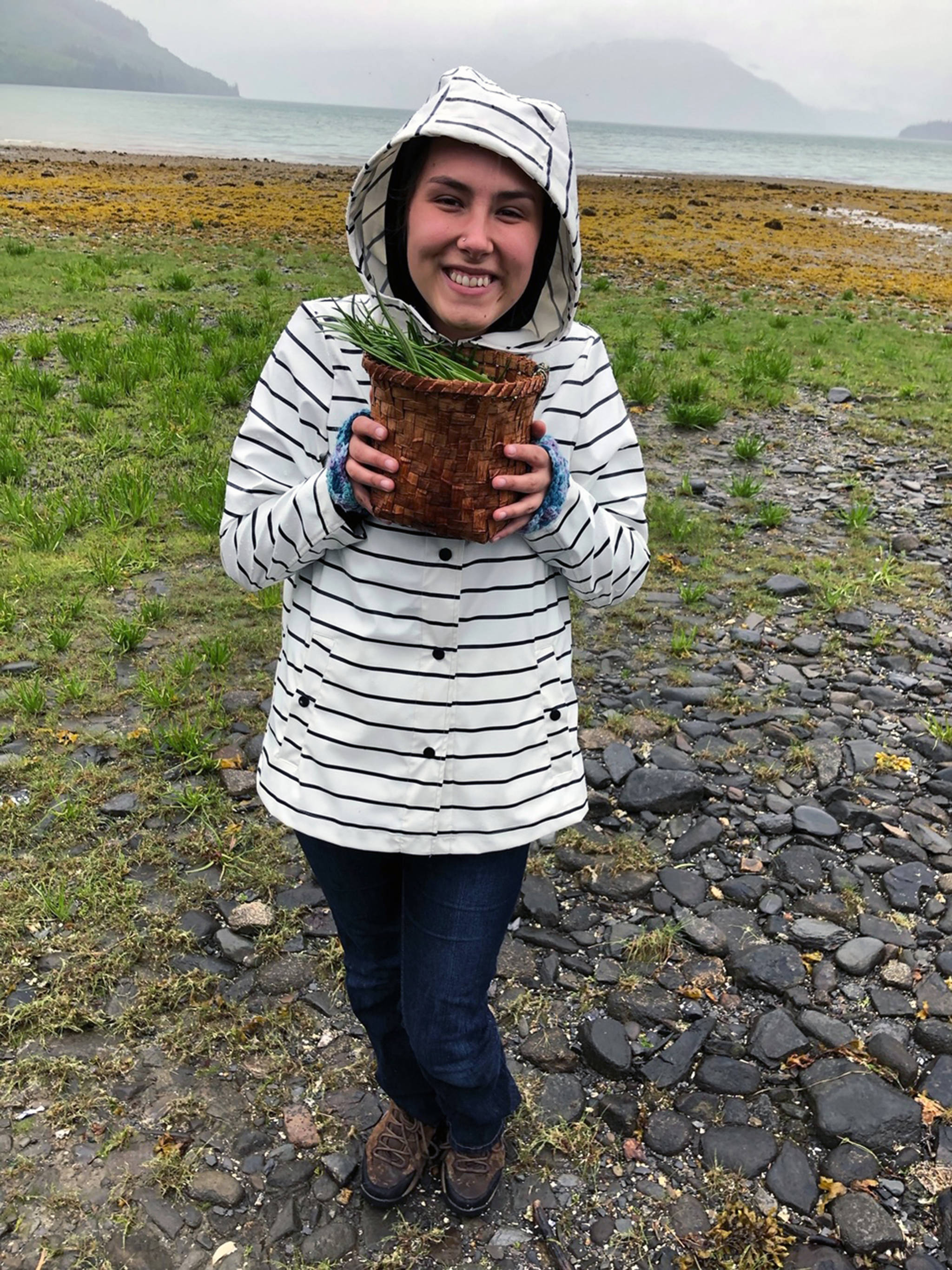 Maleah Wenzel harvests goose tongue while on summer break in Wrangell, June 11, 2019. (Courtesy photo | Vivian Faith Prescott)