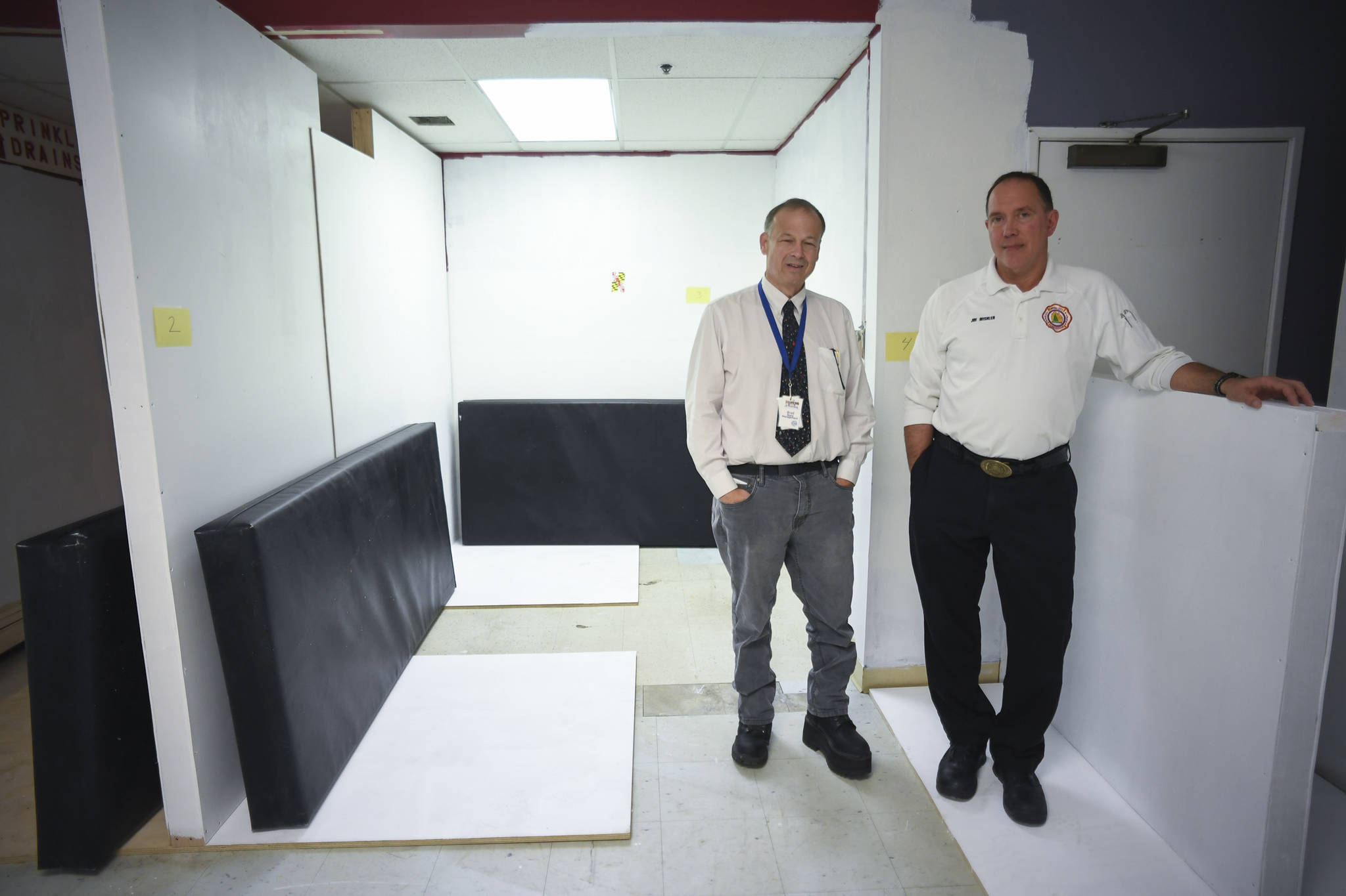 Bradley Perkins, General Manager of St. Vincent de Paul Society Juneau, left, and Joe Mishler, the Emergency Medical Services Training Officer for Capital City Fire/Rescue, stand in a temporary space created as a sleep off center at the Dan Austin Transitional Support Service Center at St. Vincent de Paul on Friday, July 19, 2019. (Michael Penn | Juneau Empire)