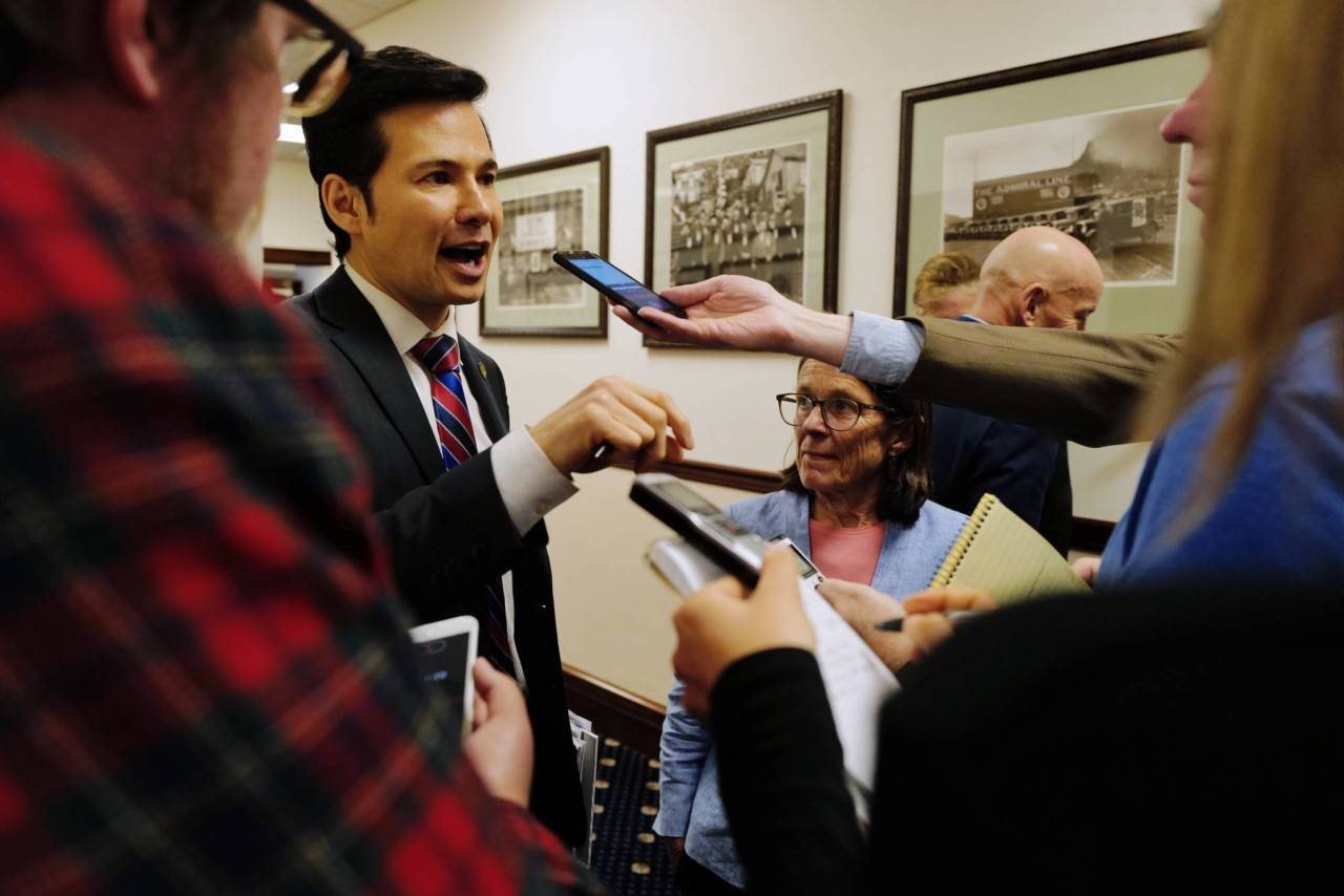 House Finance Committee Co-Chairs Neal Foster, D-Nome, and Jennifer Johnston, R-Anchorage, speaks to members of the media during an at ease in a House session at the Capitol on Wednesday, July 24, 2019. (Michael Penn | Juneau Empire)