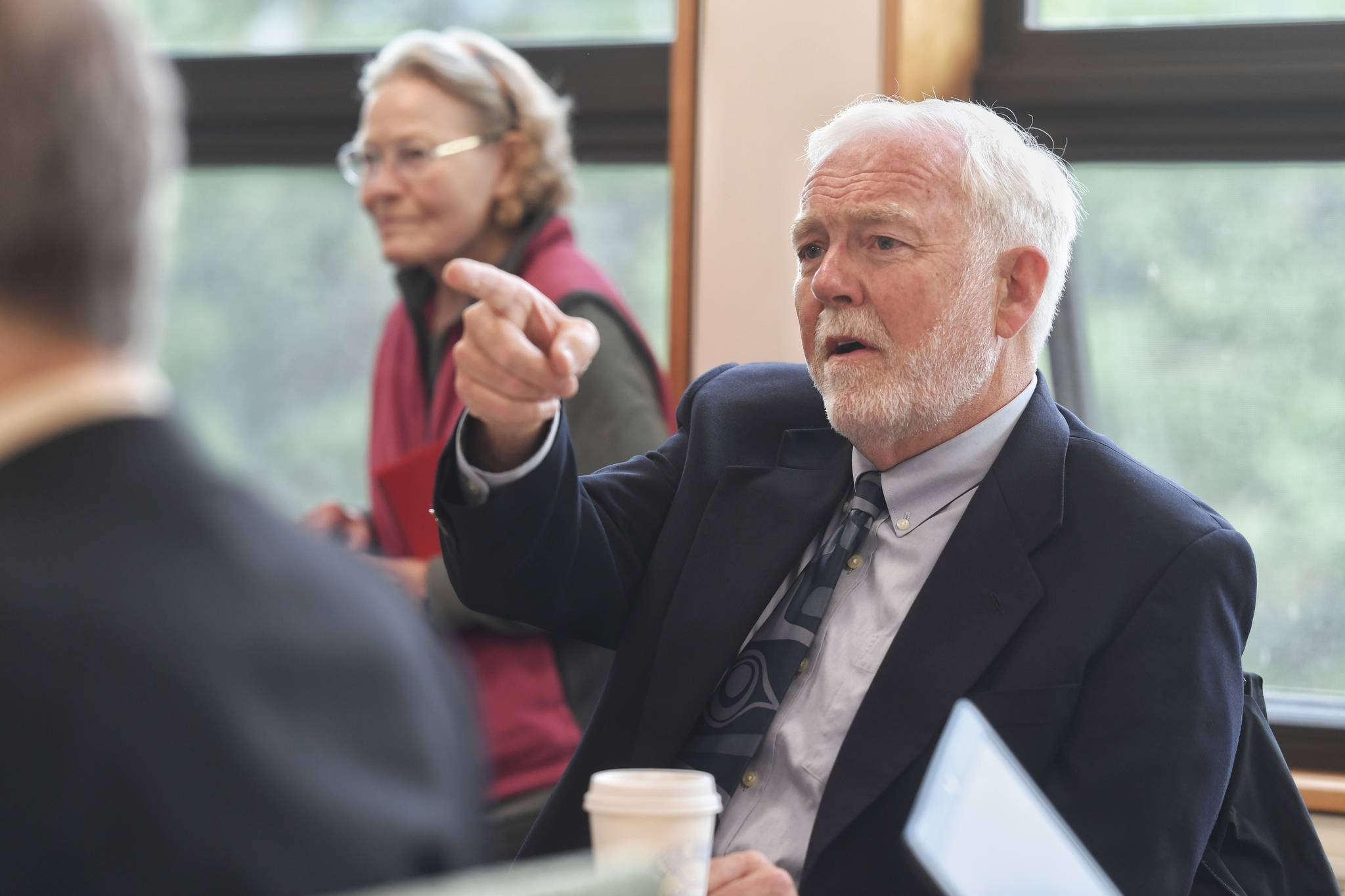 Dr. Richard Caulfield, Chancellor at the University of Alaska Southeast, watches an online meeting being held at UA campuses around the state on Gov. Mike Dunleavy's budget cuts on Monday, July 15, 2019. (Michael Penn | Juneau Empire File)