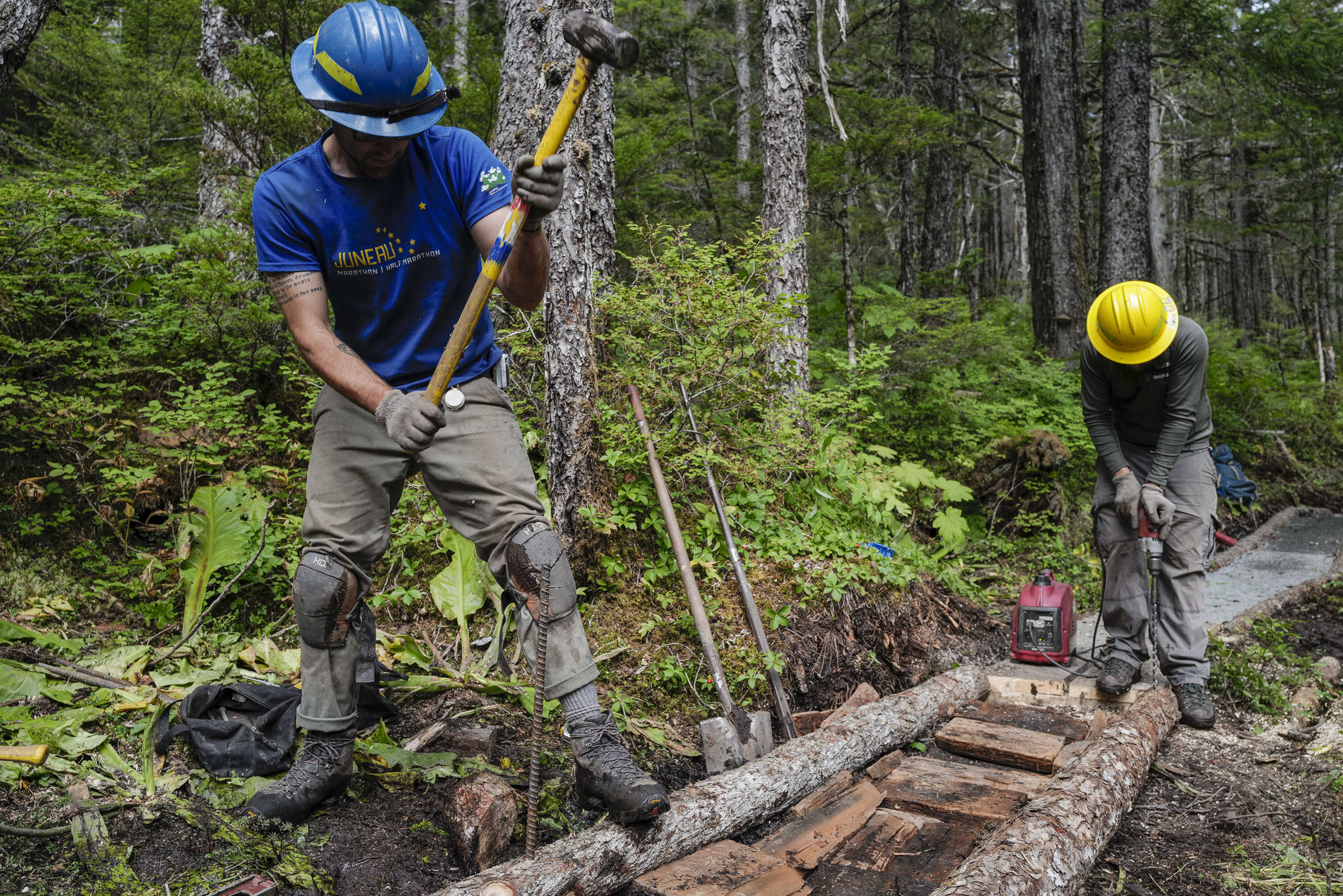 Andres Velez, left, and Lou Eney work on the Auke Nu Trail on the way to the John Muir Cabin on Wednesday, Aug. 7, 2019. (Michael Penn | Juneau Empire)