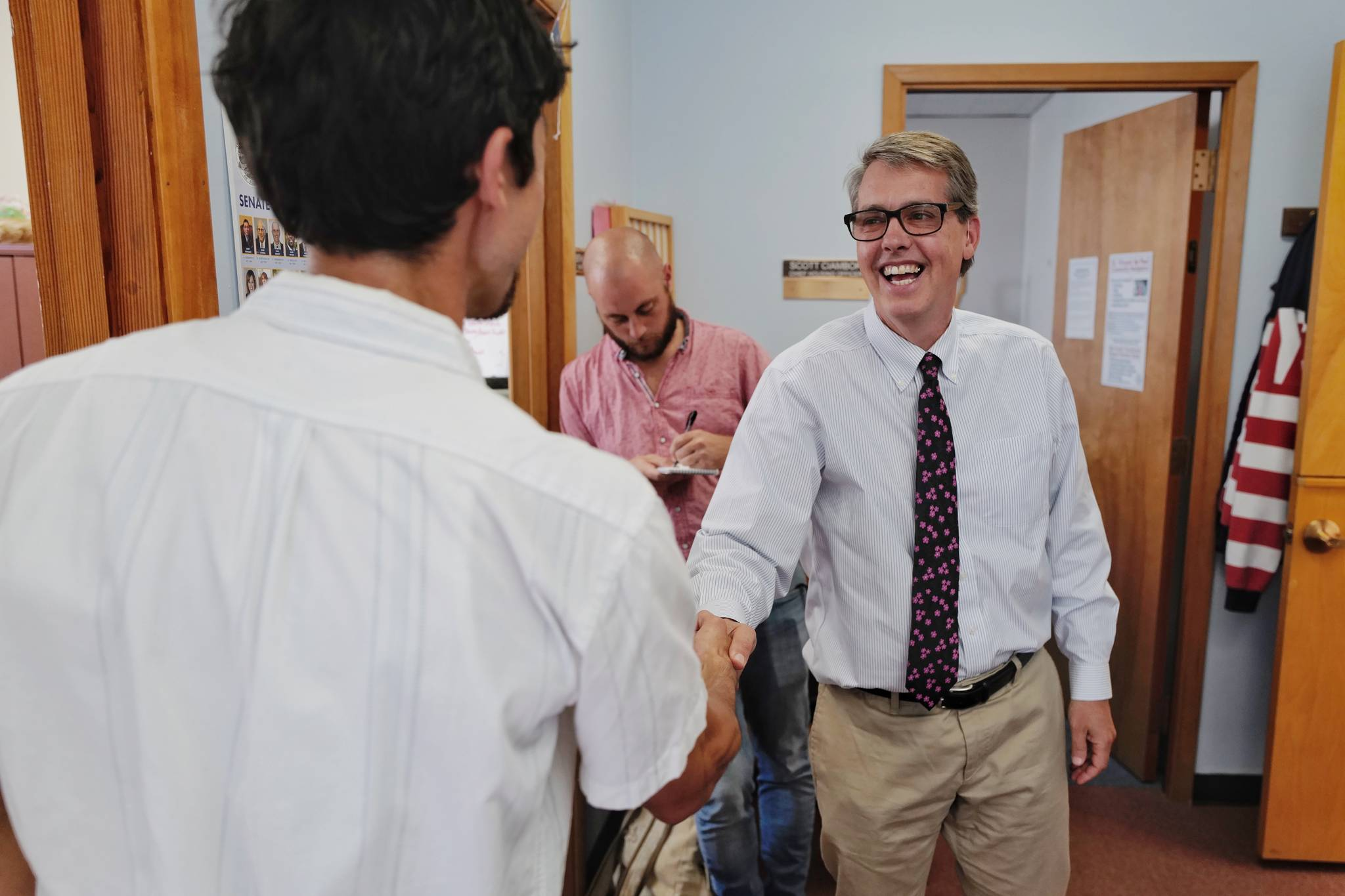 "Juneau City Manager Rorie Watt, right, greets Greg Smith after Smith applied to run for one of two Assembly District 1 seats in this falls municipal election on Monday, Aug. 12, 2019. Watt said, ""Welcome to the fray."" (Michael Penn 