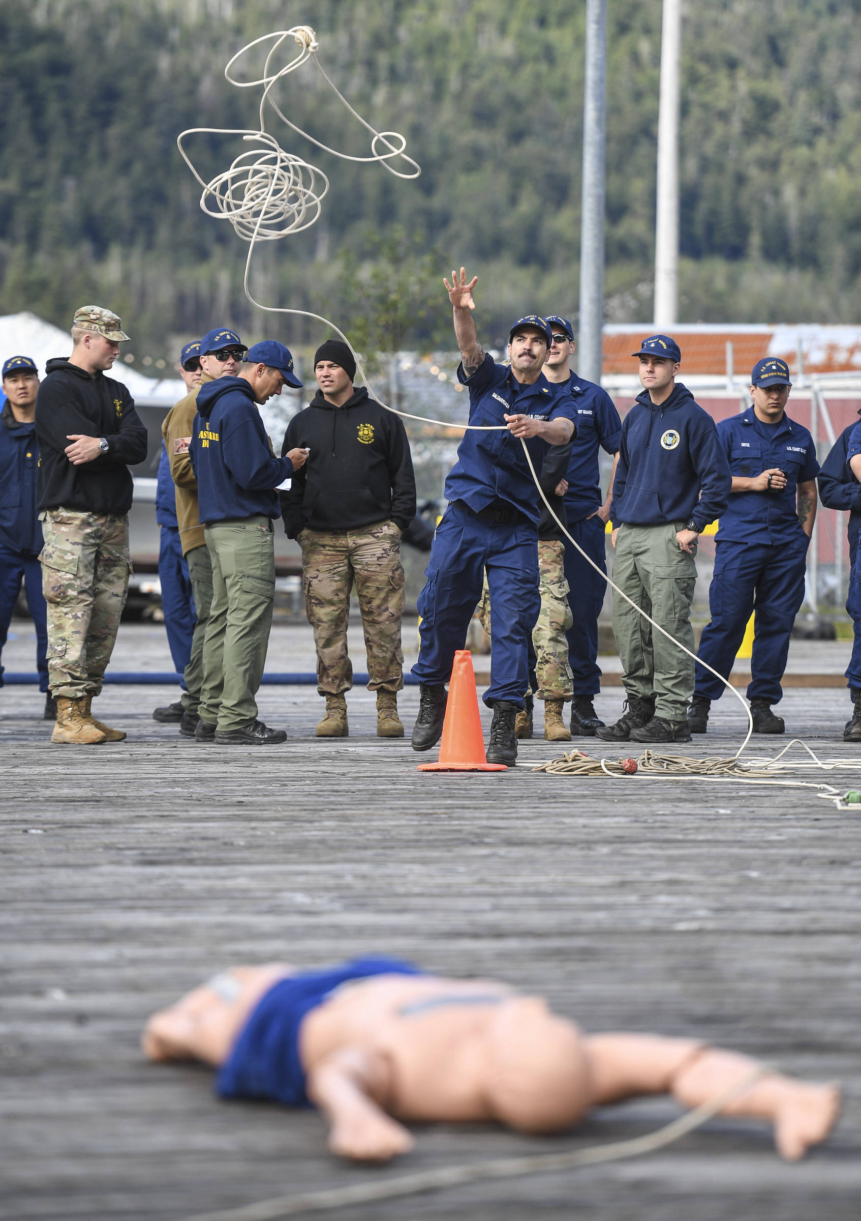 Marcos Saldarriaga, of the U.S. Coast Guard Cutter Kukui, competes in the rope throw during the annual Buoy Tender Olympics at Station Juneau on Wednesday, Aug. 21, 2019. (Michael Penn | Juneau Empire)