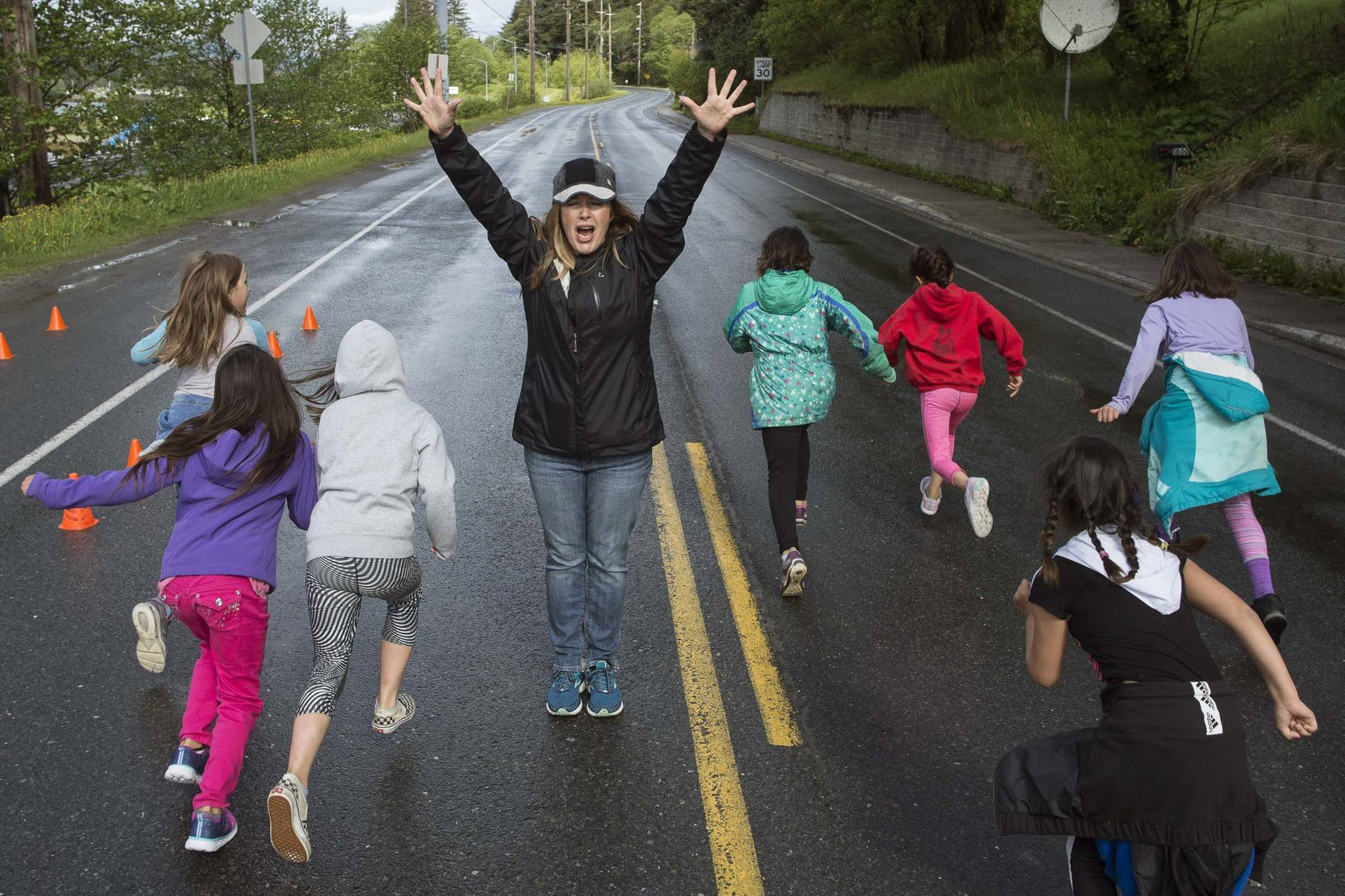 Physical Education Teacher Nikki Richert send students off for Harborview Elementary School's annual Fun Run along Glacier Avenue on Friday, May 17, 2019. Students from Montessori Borealis also ran the three mile course. (Michael Penn | Juneau Empire)