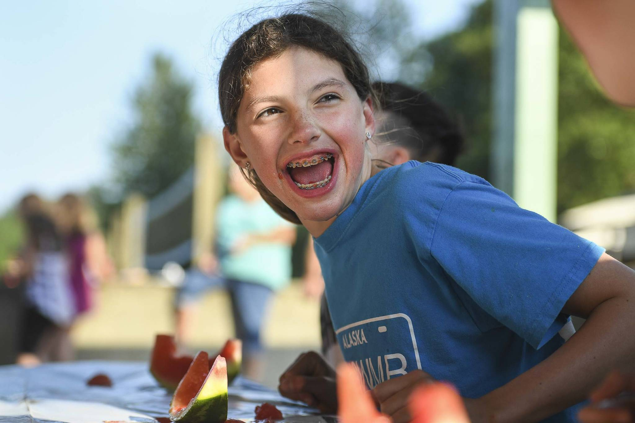 Emma Fellman, 12, celebrates her watermelon eating contest win for her age group during a community picnic sponsored by the Douglas Fourth of July Committee and Capital City Fire/Rescue at Sandy Beach on Wednesday, July 3, 2019. (Michael Penn | Juneau Empire)