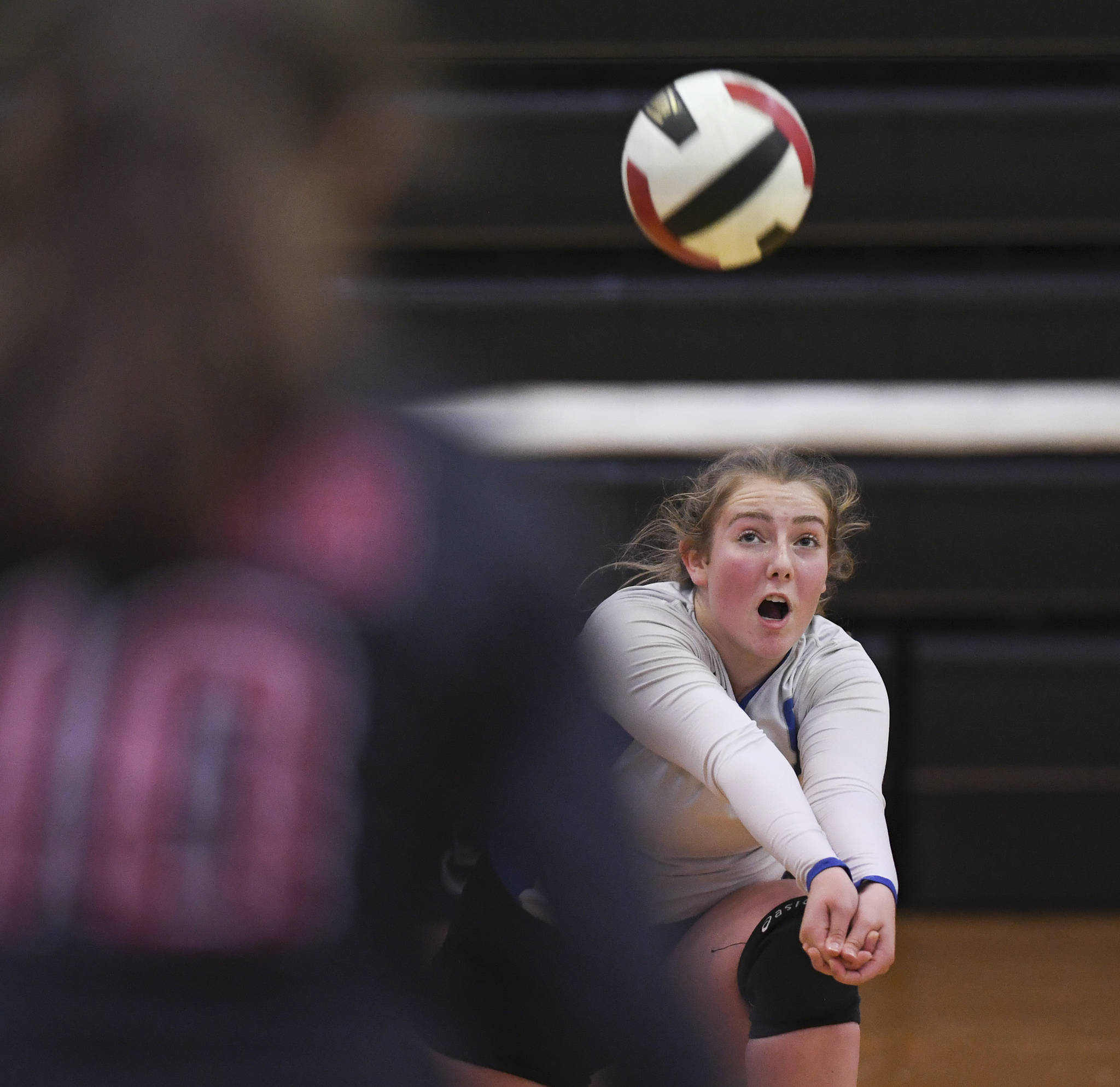 Thunder Mountain's Ann Steinman bumps the ball up against Juneau-Douglas at the Volleyball Jamboree at Juneau-Douglas High School: Yadaa.at Kalé on Friday, Aug. 30, 2019. (Michael Penn | Juneau Empire)