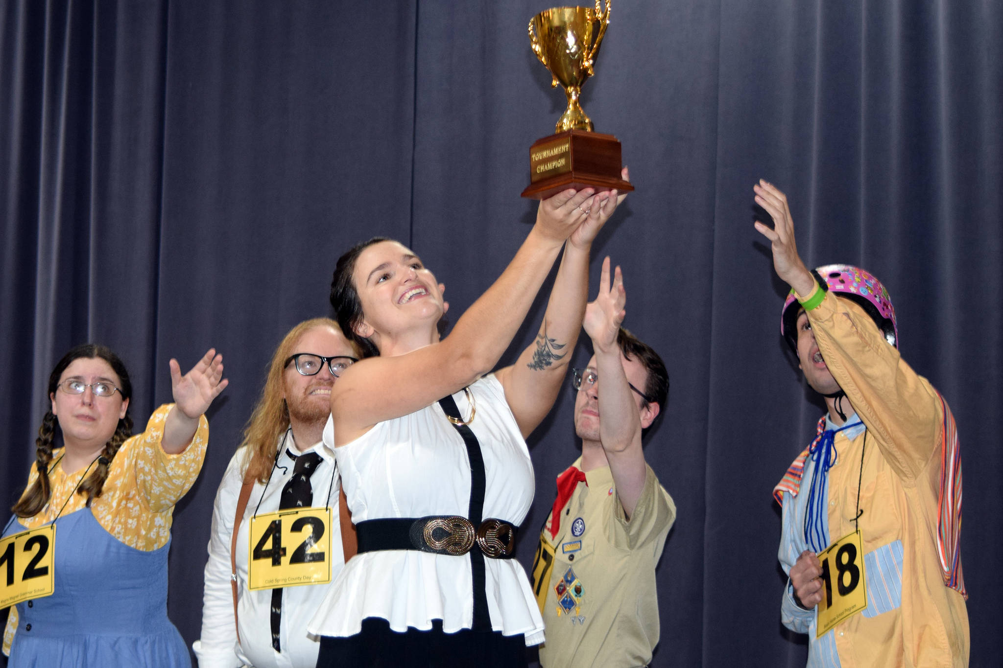 "Logainne Schwartzandgrubenniere (Kristina Paulick), William Barfee (Nomi Saxton), Chip Tolentino (Zebadiah Bodine) and Leaf Coneybear (Felix Thillet) covet a trophy held aloft by Rona Liza Perretti (Jess Skiba) during rehearsals for ""The 25th Annual Putnam County Spelling Bee"" Tuesday, Sept. 3, 2019. (Ben Hohenstatt 