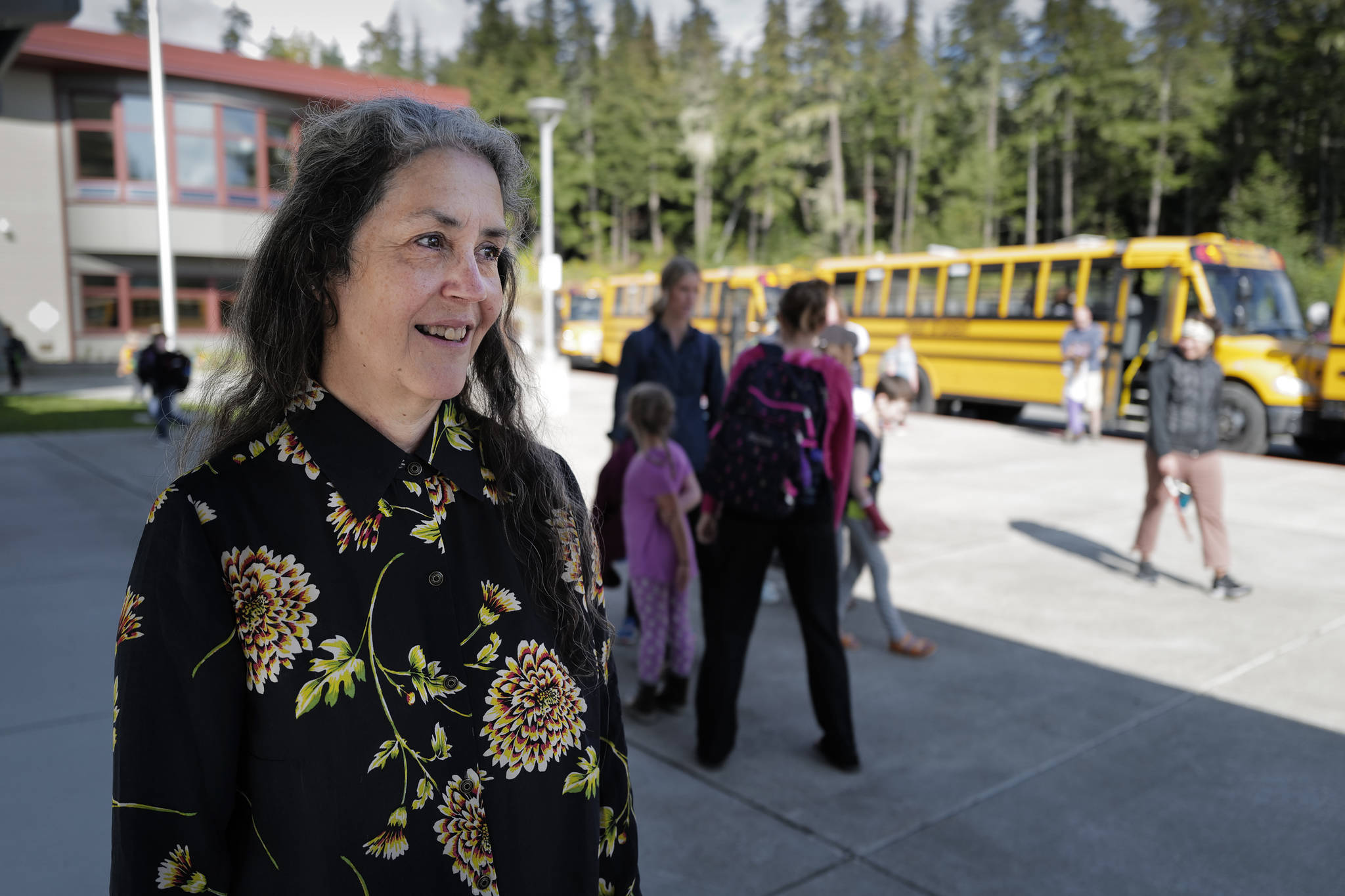 Pam Garcia, a long-time educator at Auke Bay Elementary School, watches as students catch their buses after school on Tuesday, Sept. 3, 2019. Garcia was named as one of three finalist for Alaska Teacher of the Year. (Michael Penn   Juneau Empire)