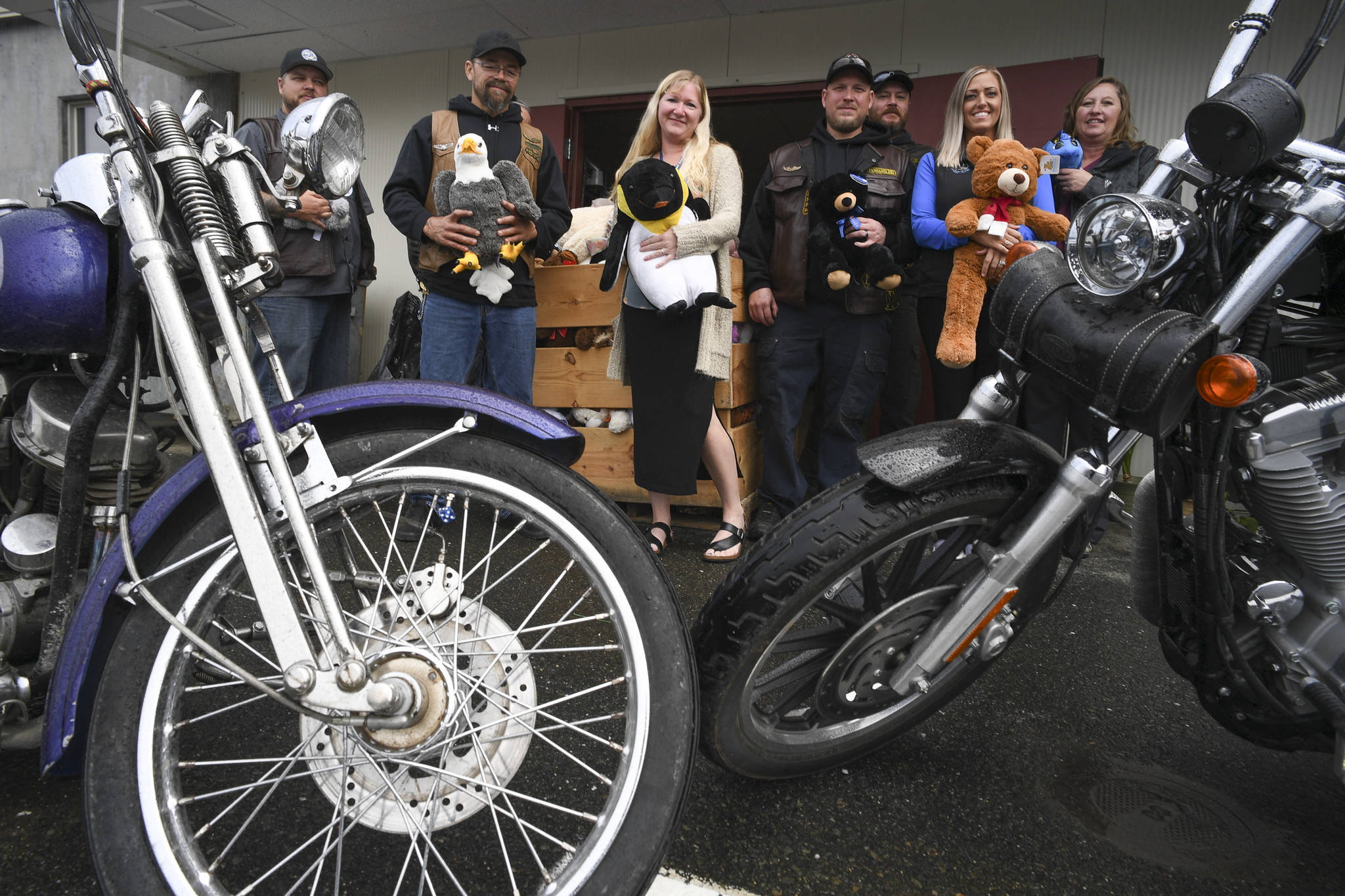Members of the Panhandlers Motorcycle Club of Alaska pose with staff at Bartlett Regional Hospital on Tuesday, Sept. 3, 2019, with toys collected during the 25th Annual Toy Run for young patients and visitors to the hospital. (Michael Penn | Juneau Empire)