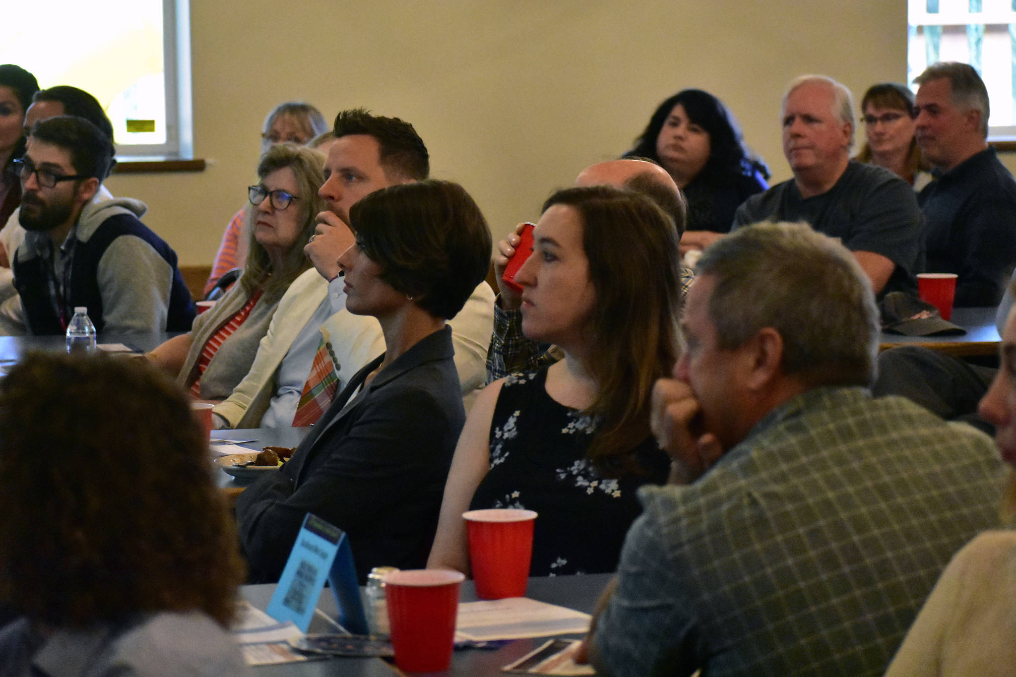 The audience at the Moose Lodge listens to Frank Reid speak at the Juneau Chamber of Commerce luncheon on Thursday, Sept. 12, 2019. (Peter Segall | Juneau Empire)
