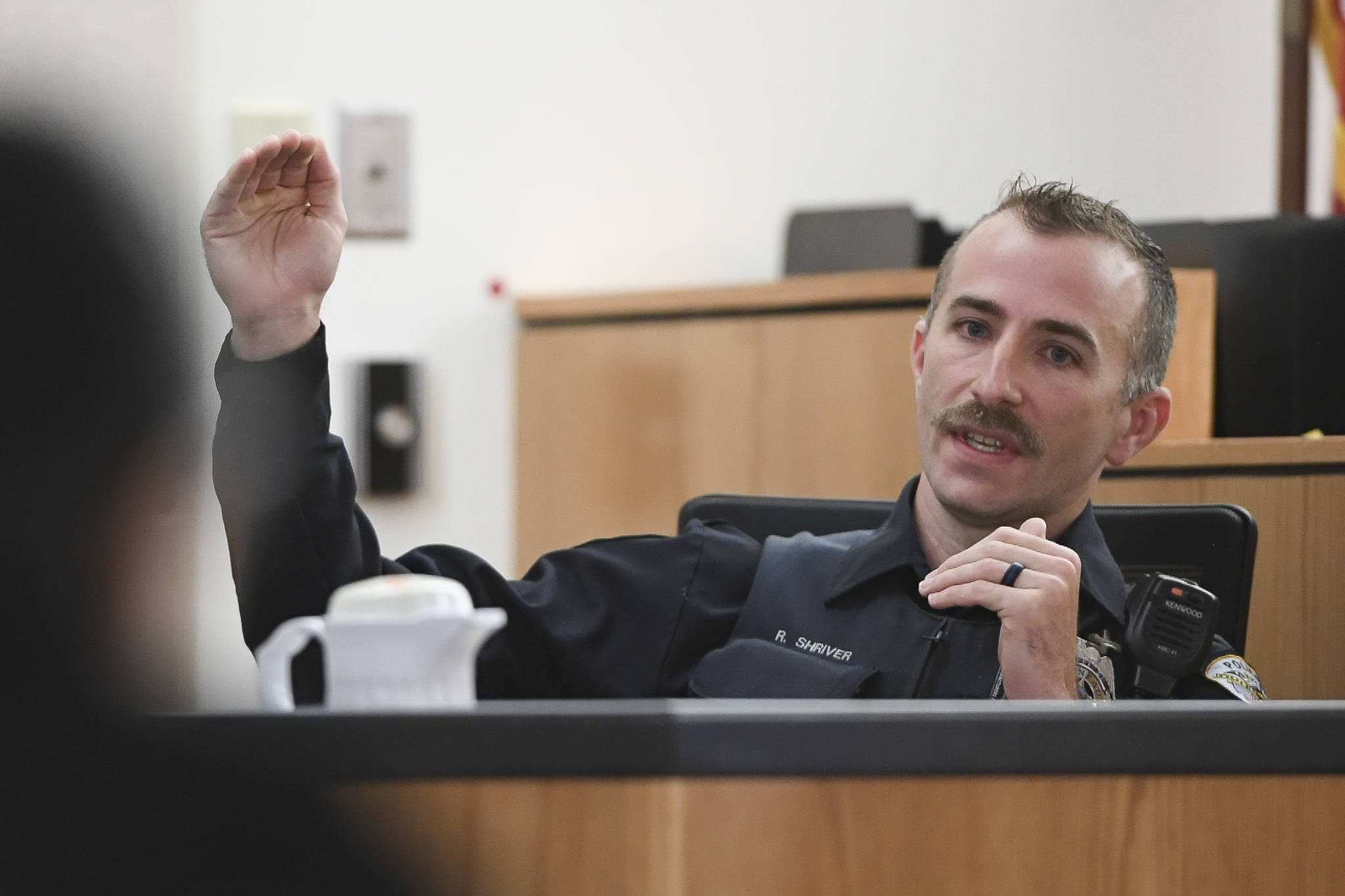 Juneau Police Department Officer Ronald Shriver answers questions on the witness stand from defense attorney Natasha Norris in Juneau Superior Court on Tuesday, Sept. 24, 2019, during Graham's trial. Graham is facing two counts of first-degree murder for the November 2015 shooting deaths of 36-year-old Robert H. Meireis and 34-year-old Elizabeth K. Tonsmeire. Shriver was a Department of Corrections officer working at Lemon Creek Correctional Center when Graham was housed there in 2016. (Michael Penn | Juneau Empire)