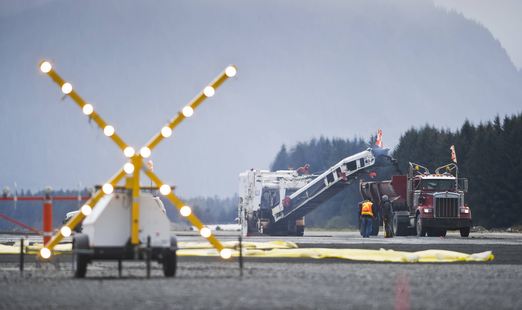 "A flashing ""X"" signals the closed runway as crews work on a repaving project at the Juneau International Airport in 2015. (Michael Penn 