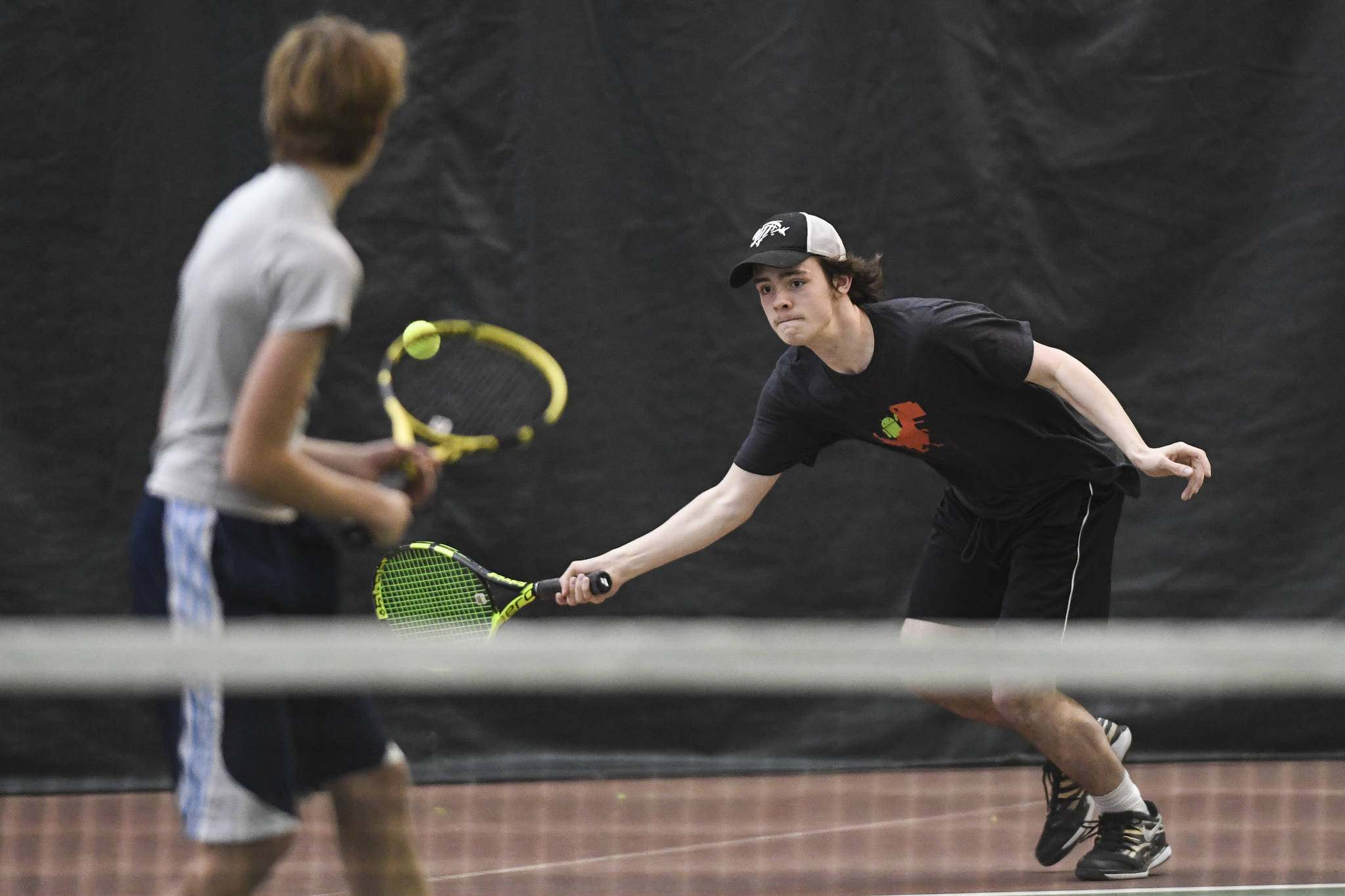 William Smoker, right, returns a forehand in a boys doubles' semifinal with partner Will Rehfeldt against Liam Penn and Callan Smith during the Region V Tennis Tournament at The Alaska Club/JRC on Saturday, Sept. 28, 2019. Smoker/Rehfeldt won 7-6, 6-2. (Michael Penn | Juneau Empire)
