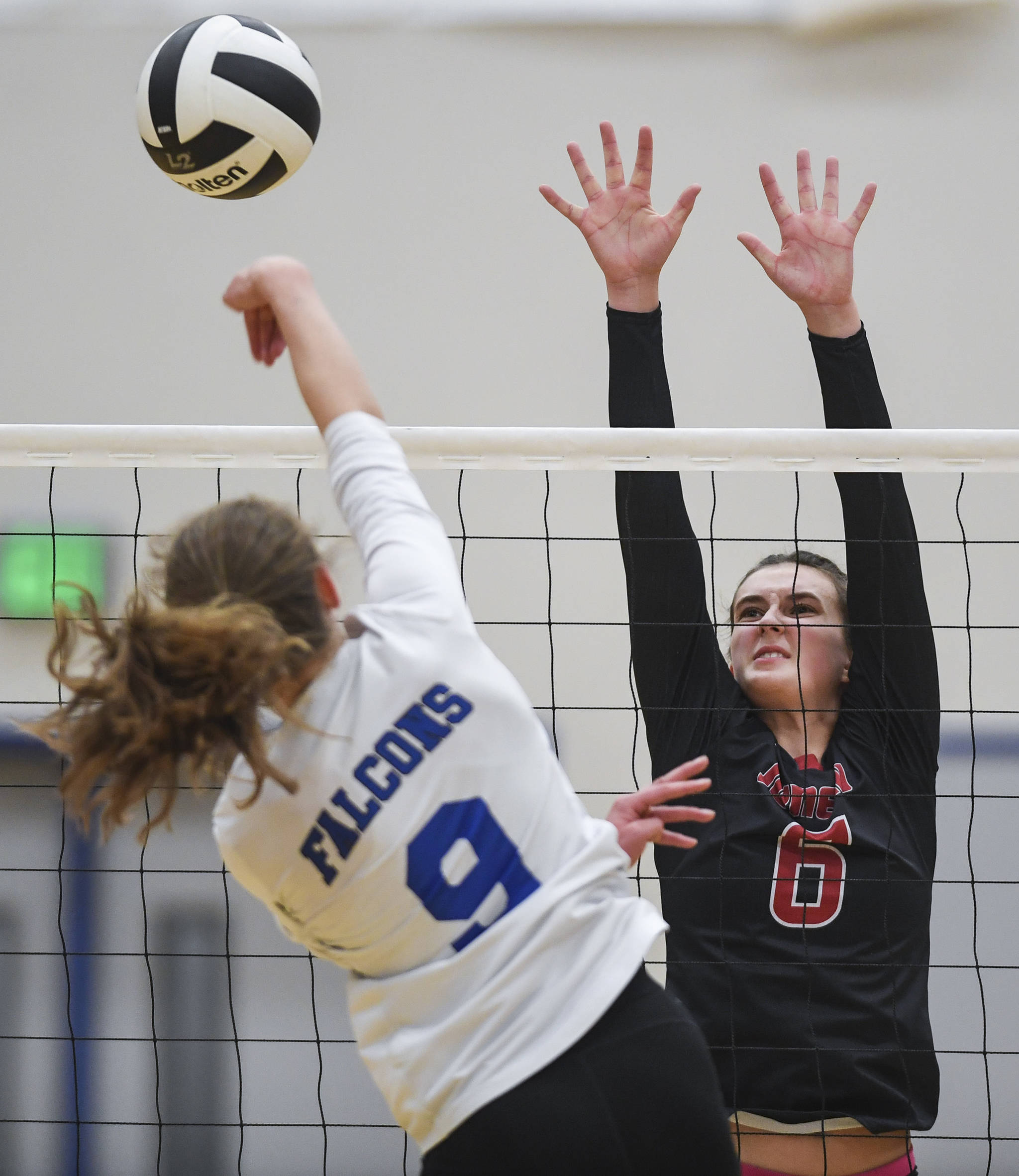 Juneau-Douglas' Addie Prussing, right, attempts a block against Thunder Mountain's Sophia Harvey at Thunder Mountain High School on Friday, Oct. 4, 2019. (Michael Penn | Juneau Empire)