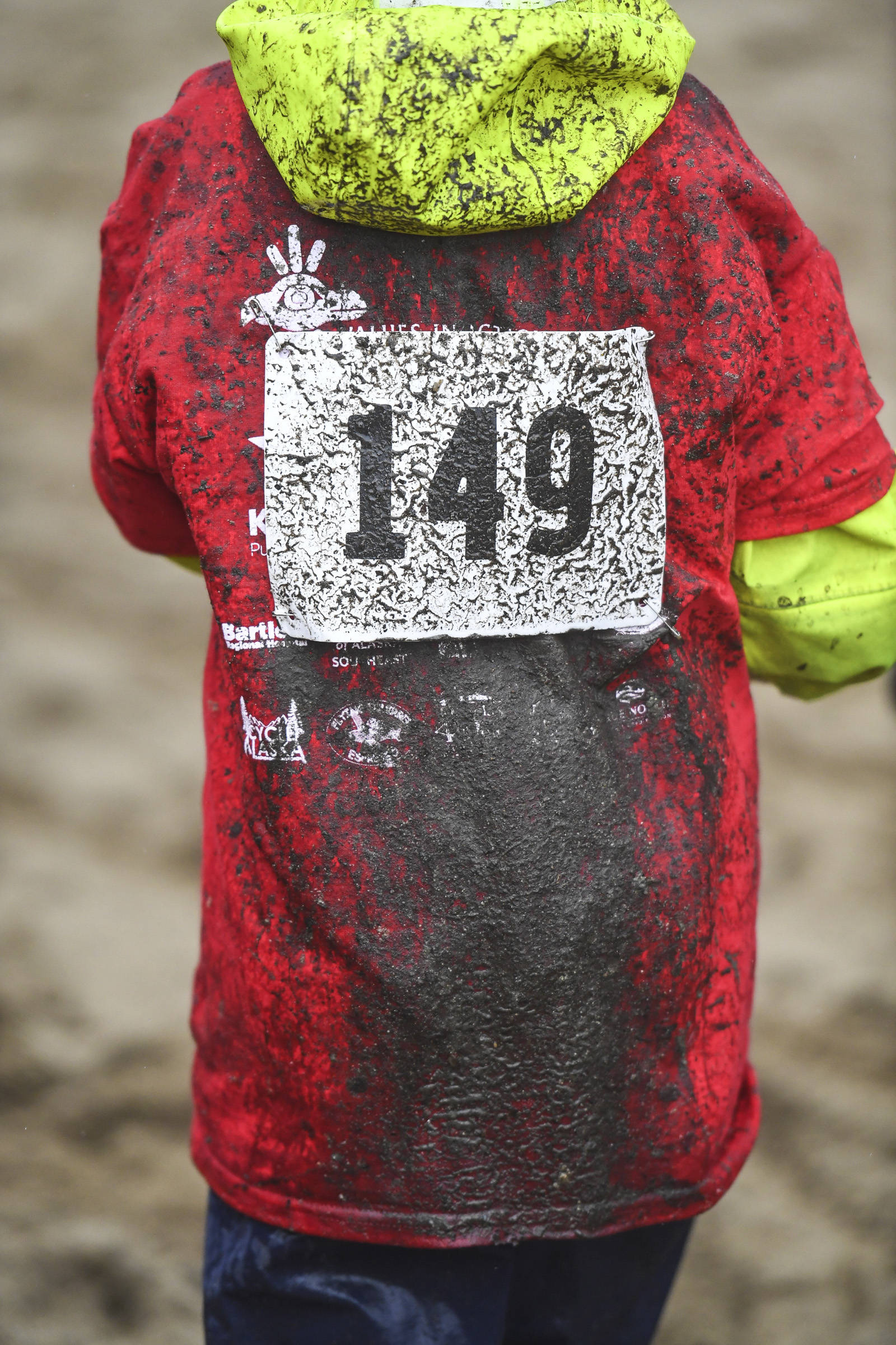 Mud splatters the backside of a rider at the Douglas Dirt Derby Youth Bike Race for 5 to 7-year-olds at Savikko Park and the Treadwell Historic Trail on Saturday, Oct. 5, 2019. The event was organized by the Juneau Freewheelers Bicycle Club. (Michael Penn | Juneau Empire)