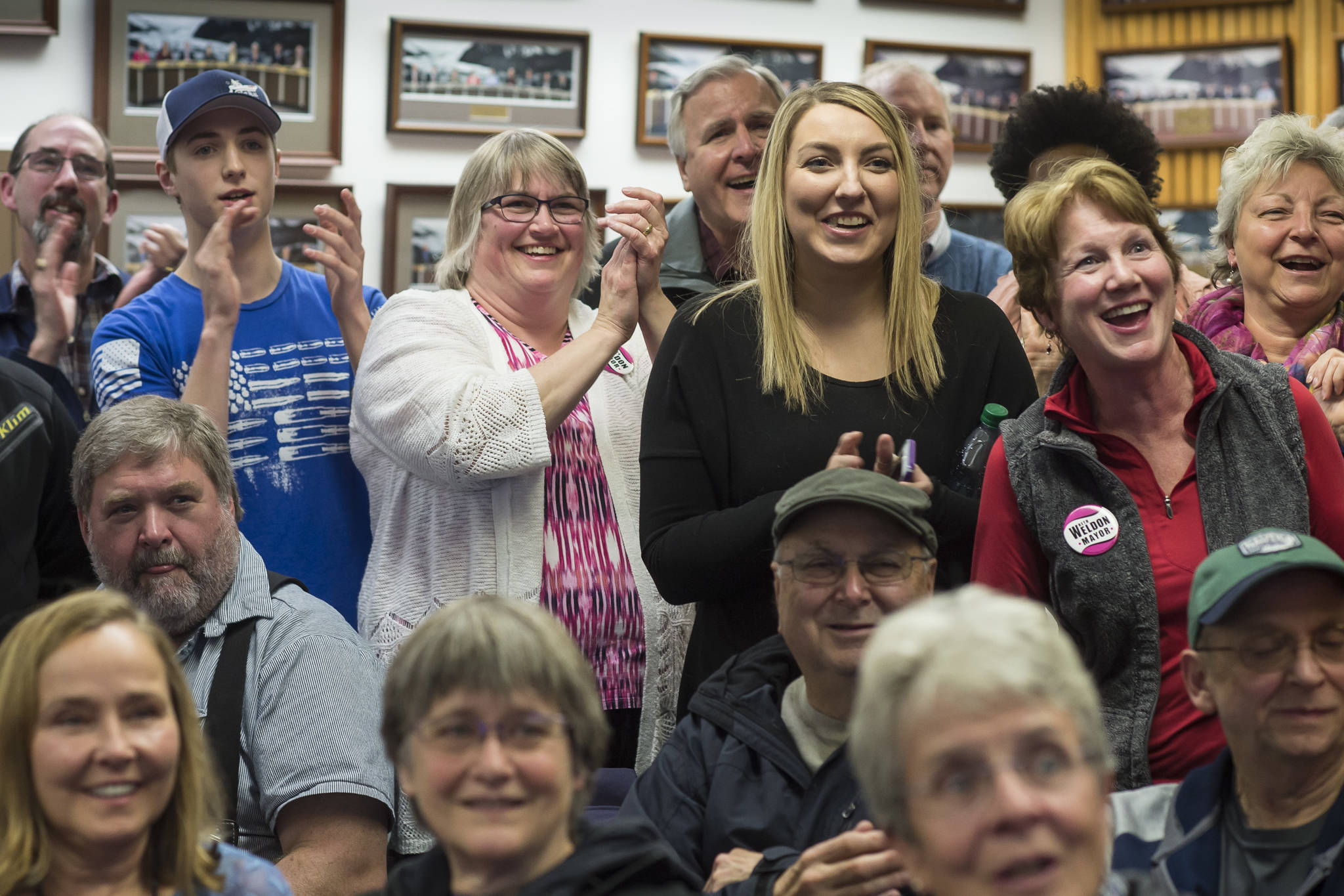 In this Empire file photo, then mayoral candidate Beth Weldon, with family and friends, react as they watch Election results come in at the Assembly chambers on Tuesday, Oct. 2, 2018. (Michael Penn | Juneau Empire File)