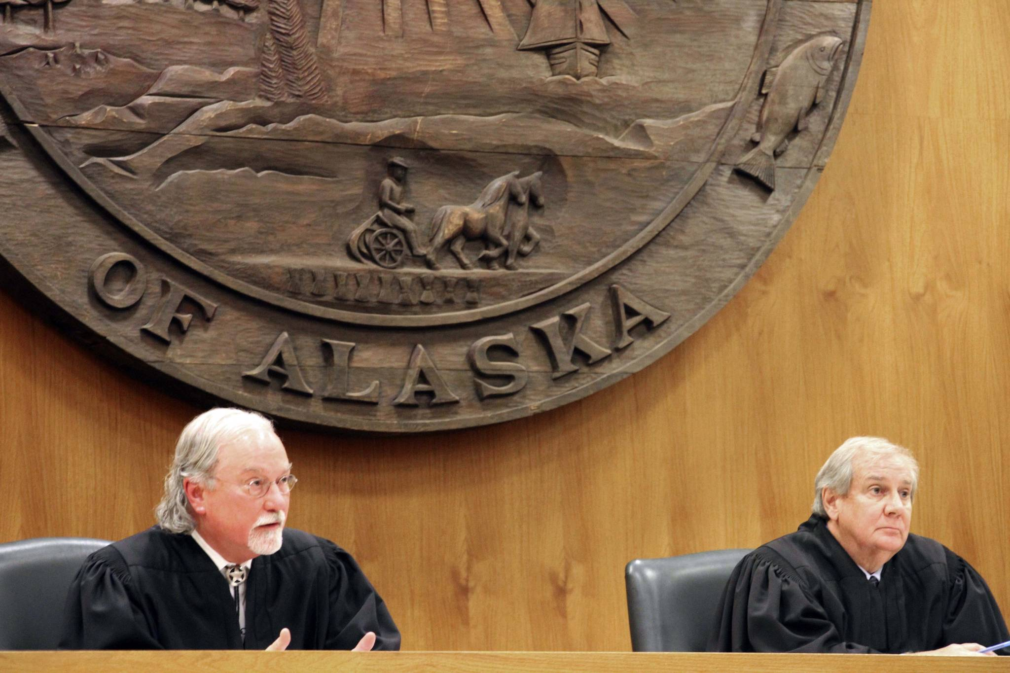 Alaska Supreme Court Justices Craig Stowers, left, and Daniel Winfree listen to arguments in a lawsuit that claims state policy on fossil fuels is harming the constitutional right of young Alaskans to a safe climate Wednesday in Anchorage. Sixteen Alaska youths in 2017 sued the state, claiming that human-caused greenhouse gas emission leading to climate change is creating long-term, dangerous health effects. They lost in Superior Court, but appealed to Alaska's highest court. (AP Photo | Mark Thiessen)
