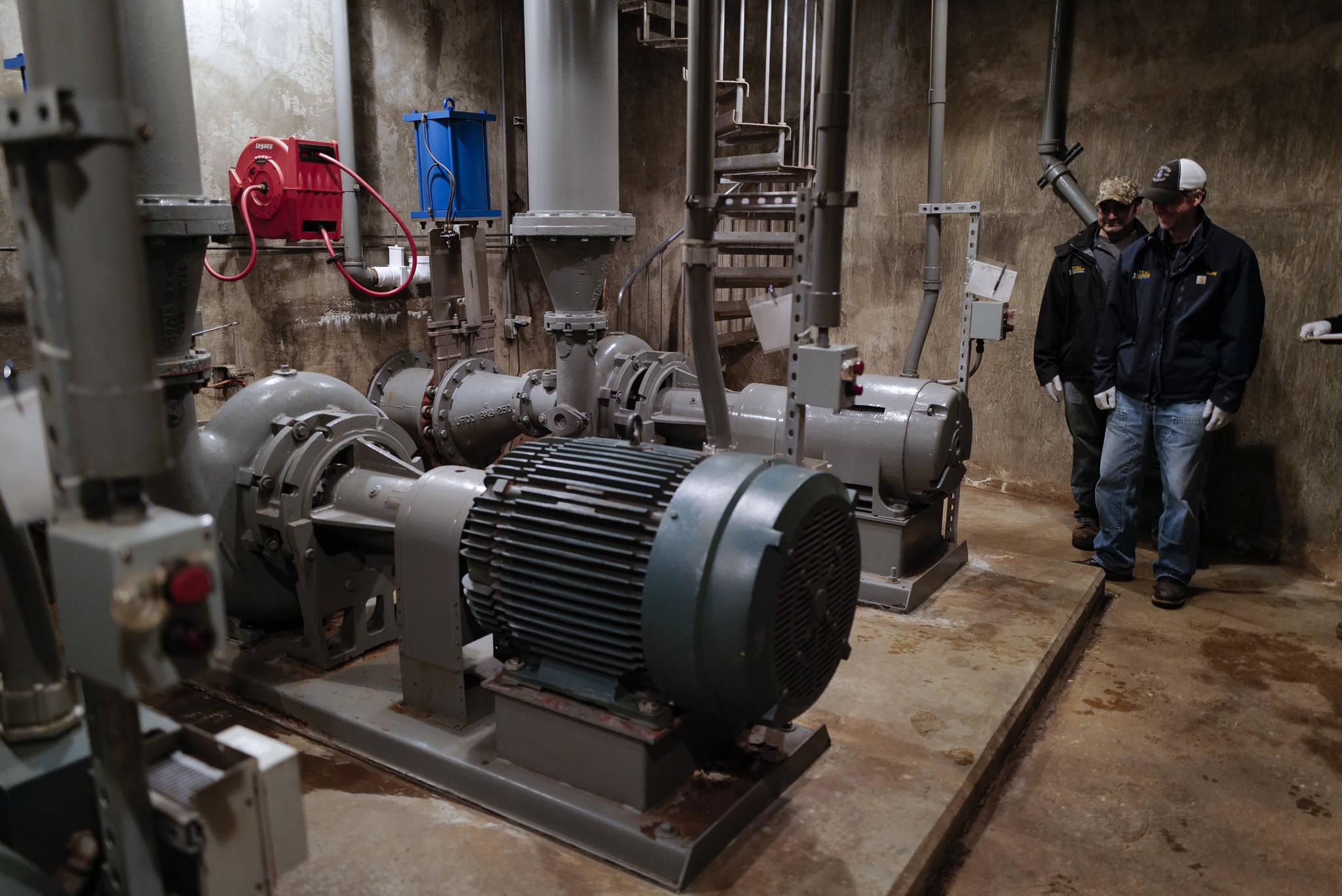 Otto Dunayski, left, and Scott Simonson, senior wastewater collection officers for the city, inspect three pumps three-story underground at the Outer Drive Pumping Station downtown on Friday, Oct. 11, 2019. The pumps were overwhelmed during last weekend's storm that caused a backup of sewage into the Mayor Bill Overstreet Park utilities building. (Michael Penn | Juneau Empire)
