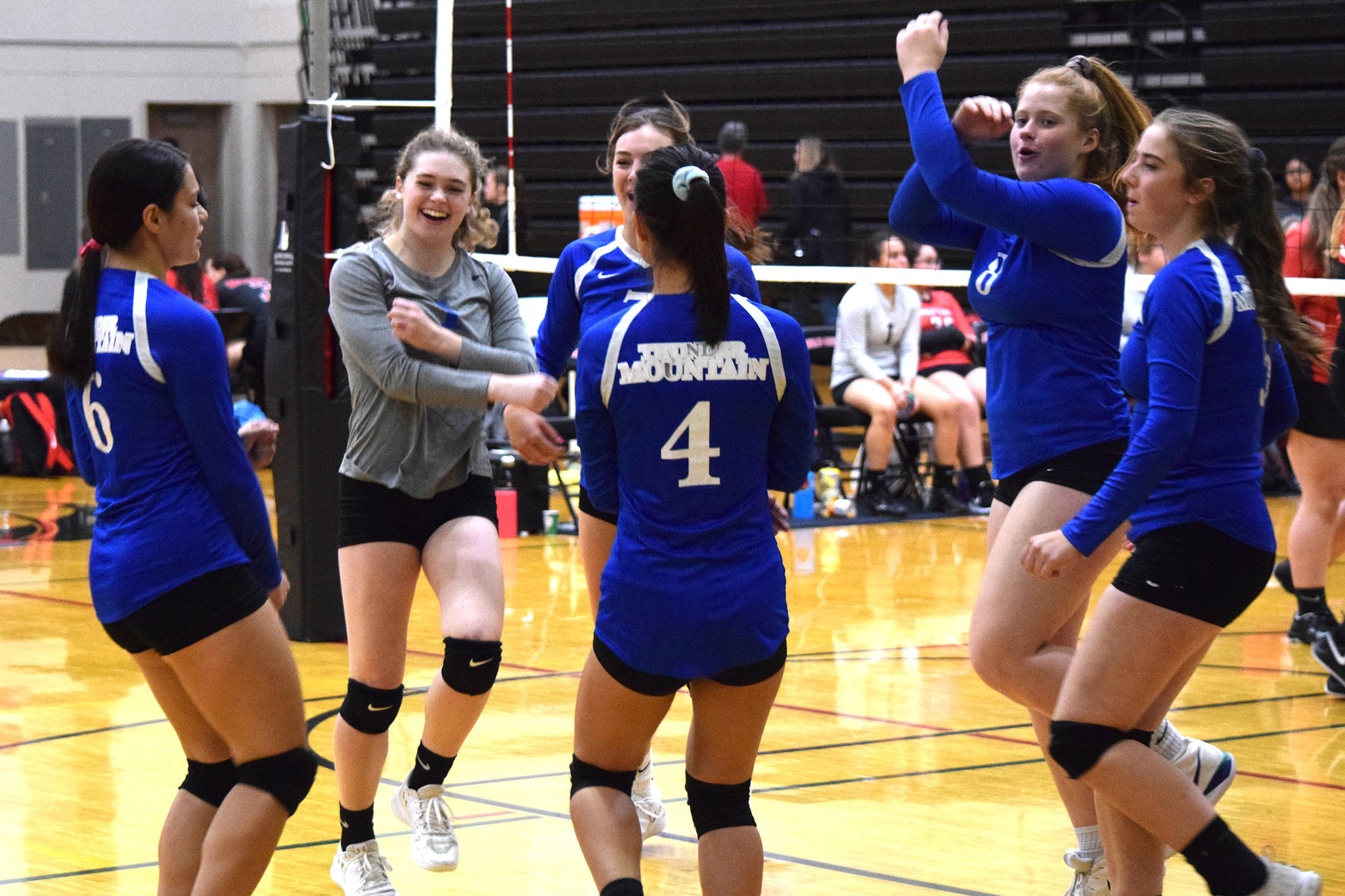Thunder Mountain High School celebrates a point against Klawock at the Juneau Invitational Volleyball Extravaganza at Juneau-Douglas High School: Yadaat.at Kalé on Friday, Oct. 11, 2019. (Nolin Ainsworth | Juneau Empire)