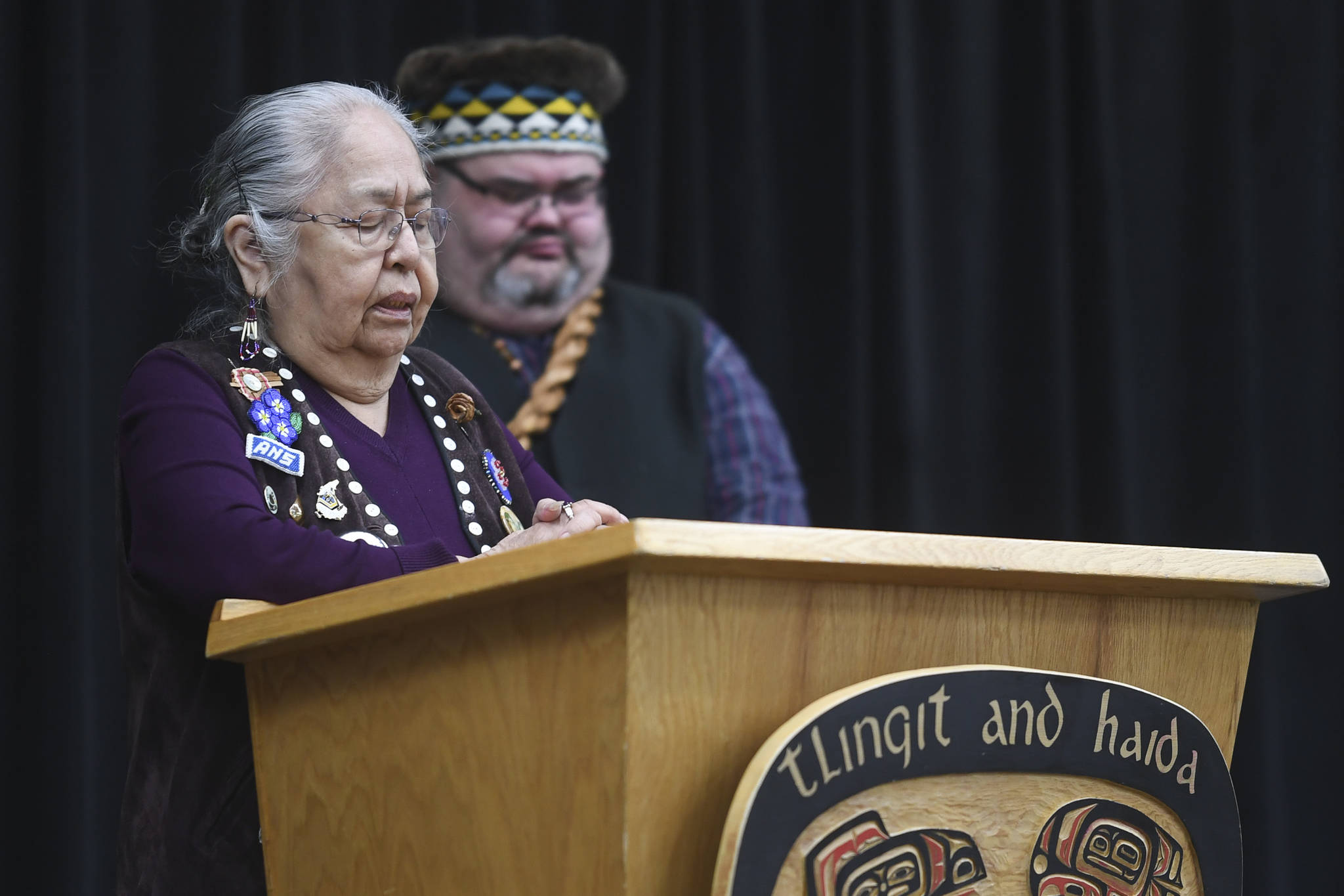 Florence Sheakley gives a prayer for Indigenous Peoples' Day at the Elizabeth Peratrovich Hall on Monday, Oct. 14, 2019. (Michael Penn | Juneau Empire)