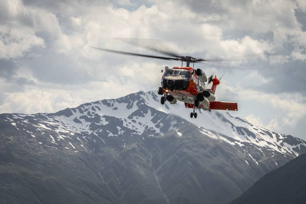 An aircrew aboard an MH-60 Jayhawk helicopter makes an approach on their return to Coast Guard Air Station Kodiak, Alaska, June 5, 2019. (U.S. Coast Guard photo by Petty Officer 1st Class Bradley Pigage.)