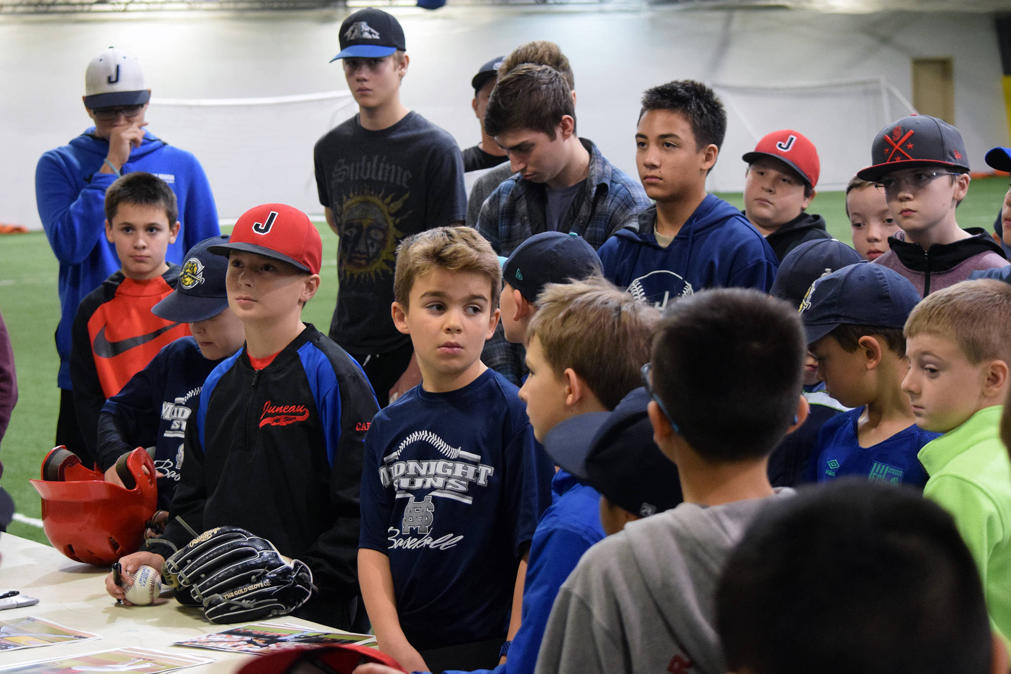 Midnight Suns Baseball Club baseball players listen to Cleveland Indians pitcher Zach Plesac at the Wells Fargo Dimond Park Field House on Thursday, Oct. 17, 2019. Approximately 70 players, parents and coaches gathered to hear Plesac's story. (Nolin Ainsworth | Juneau Empire)