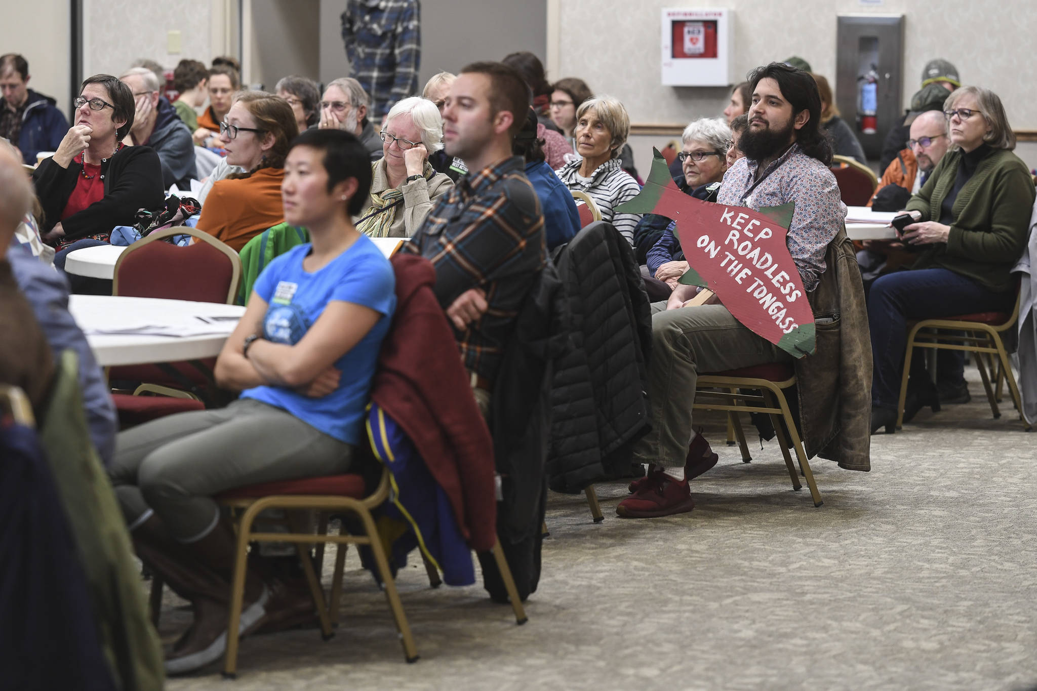 Juneau residents listen to a U.S. Department of Agriculture Forest Service meeting on the Rulemaking for Alaska Roadless Areas Draft Environmental Impact Statement at Elizabeth Peratrovich Hall on Monday, Nov. 4, 2019. (Michael Penn | Juneau Empire)