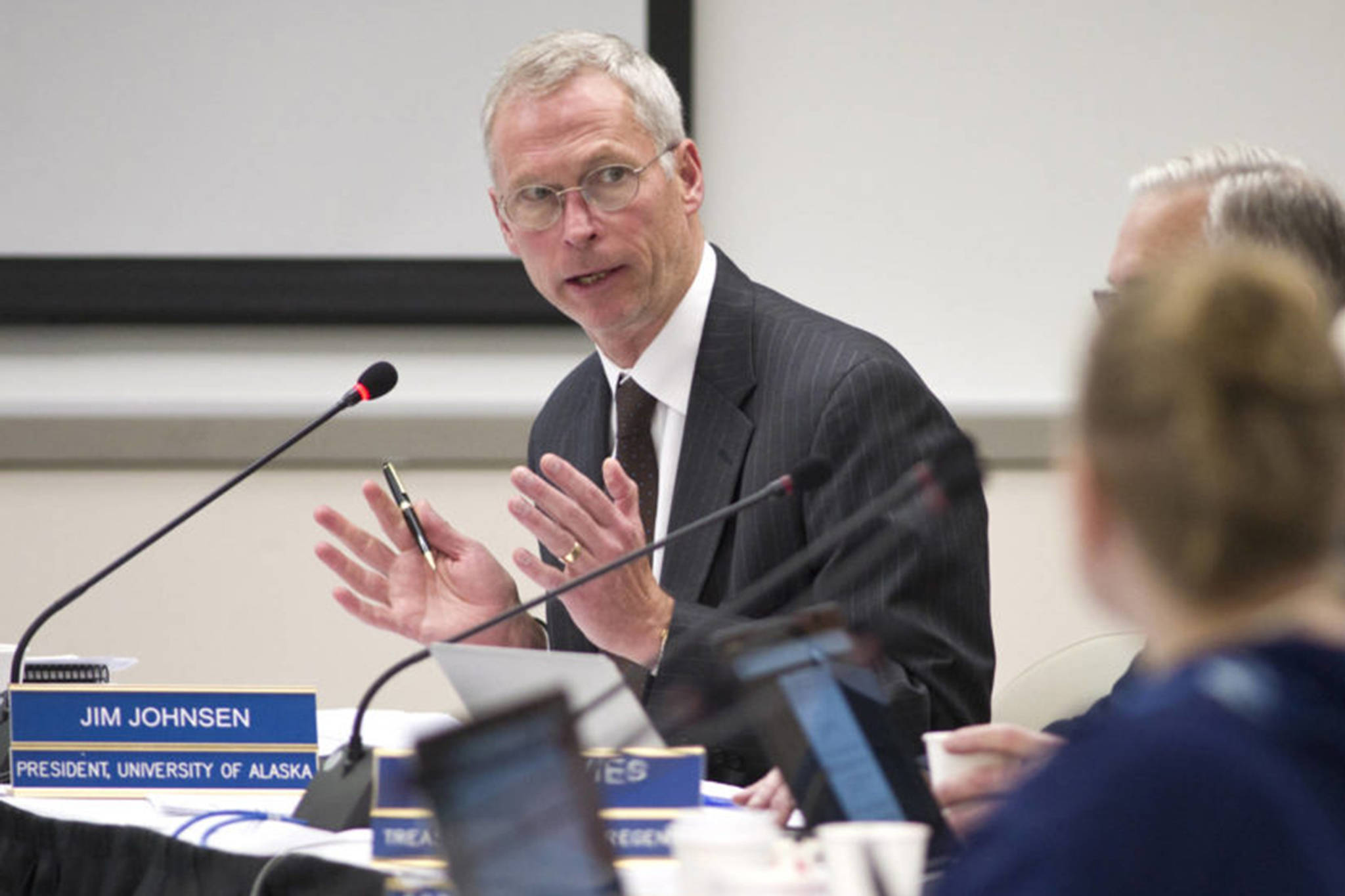 In this file photo from Sept. 15, 2016, University of Alaska President Jim Johnsen makes a presentation to the university's Board of Regents at the University of Alaska Southeast Recreation Center. Johnsen and the UA board discussed tuition increases and budget concerns Friday. (Michael Penn | Juneau Empire File)