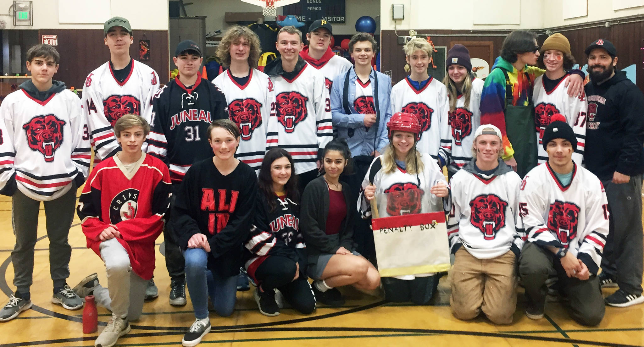 The JDHS hockey team poses for a photo after volunteering at the Douglas Ghost Walk. (Courtesy photo)