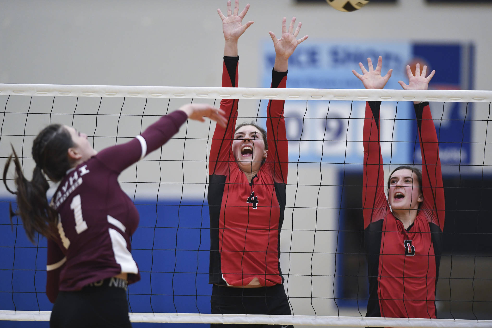 Juneau-Douglas' Jenae Pusich, center, and Addie prussing attempt to block as shot by Ketchikan's LIndsey Byron during the Region V Volleyball Tournament at Thunder Mountain High School on Thursday, Nov. 7, 2019. JDHS won 25-8, 25-14, 14-25, 25-15. (Michael Penn | Juneau Empire)