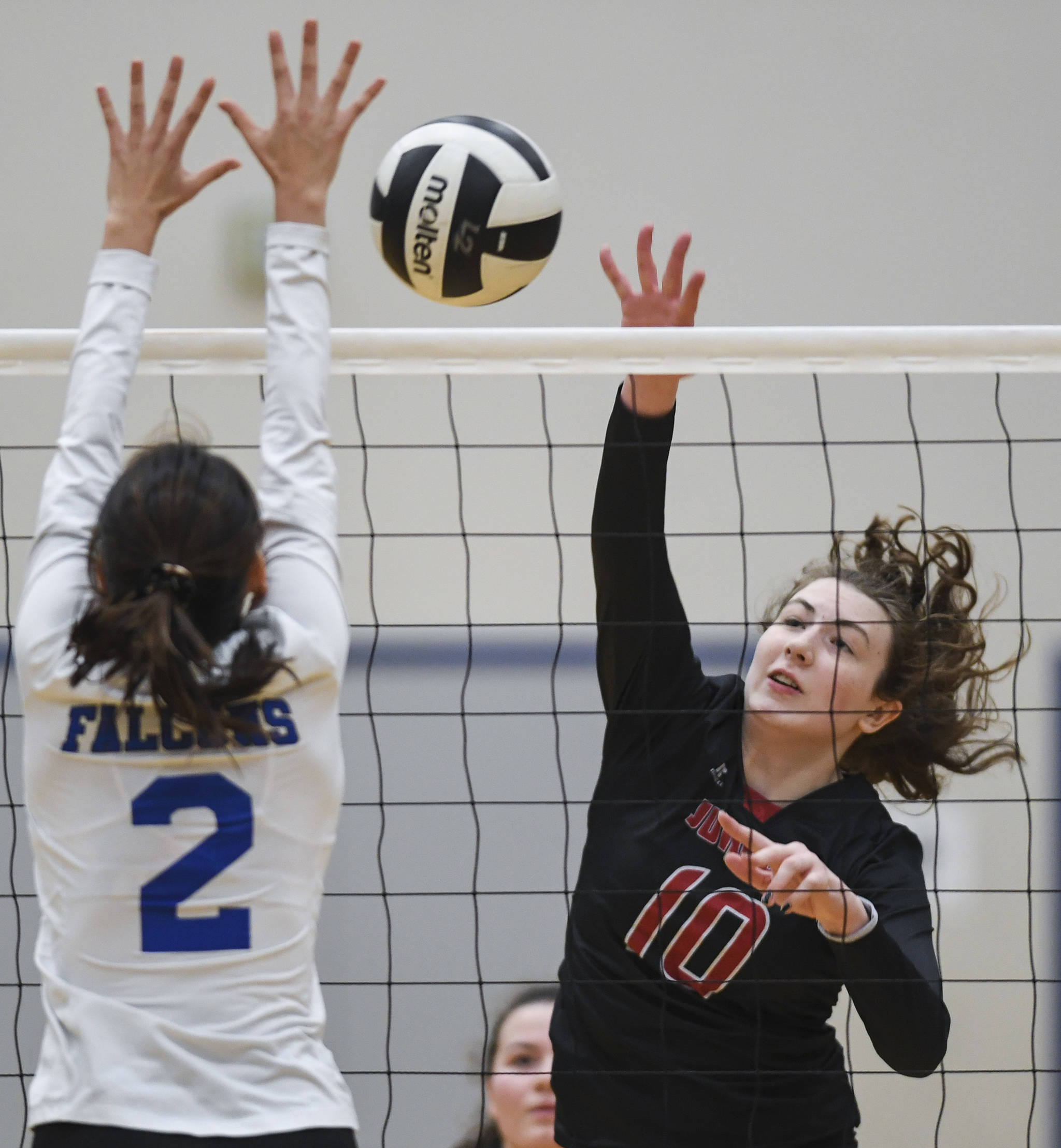 Juneau-Douglas' Merry Newman spikes the ball against Thunder Mountain's Amy Schoonover during the Region V Volleyball Tournament at Thunder Mountain High School on Friday, Nov. 8, 2019. JDHS won 25-22, 26-24, 25-20. (Michael Penn | Juneau Empire)