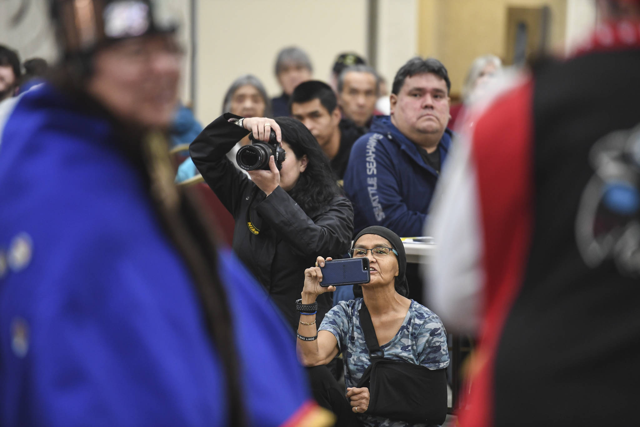 Juneau residents watch the Yaaw Tei Yi Dance Group perform during the Southeast Alaska Native Veteran's Veterans Day luncheon at the Elizabeth Peratrovich Hall on Monday, Nov. 11, 2019. (Michael Penn | Juneau Empire)